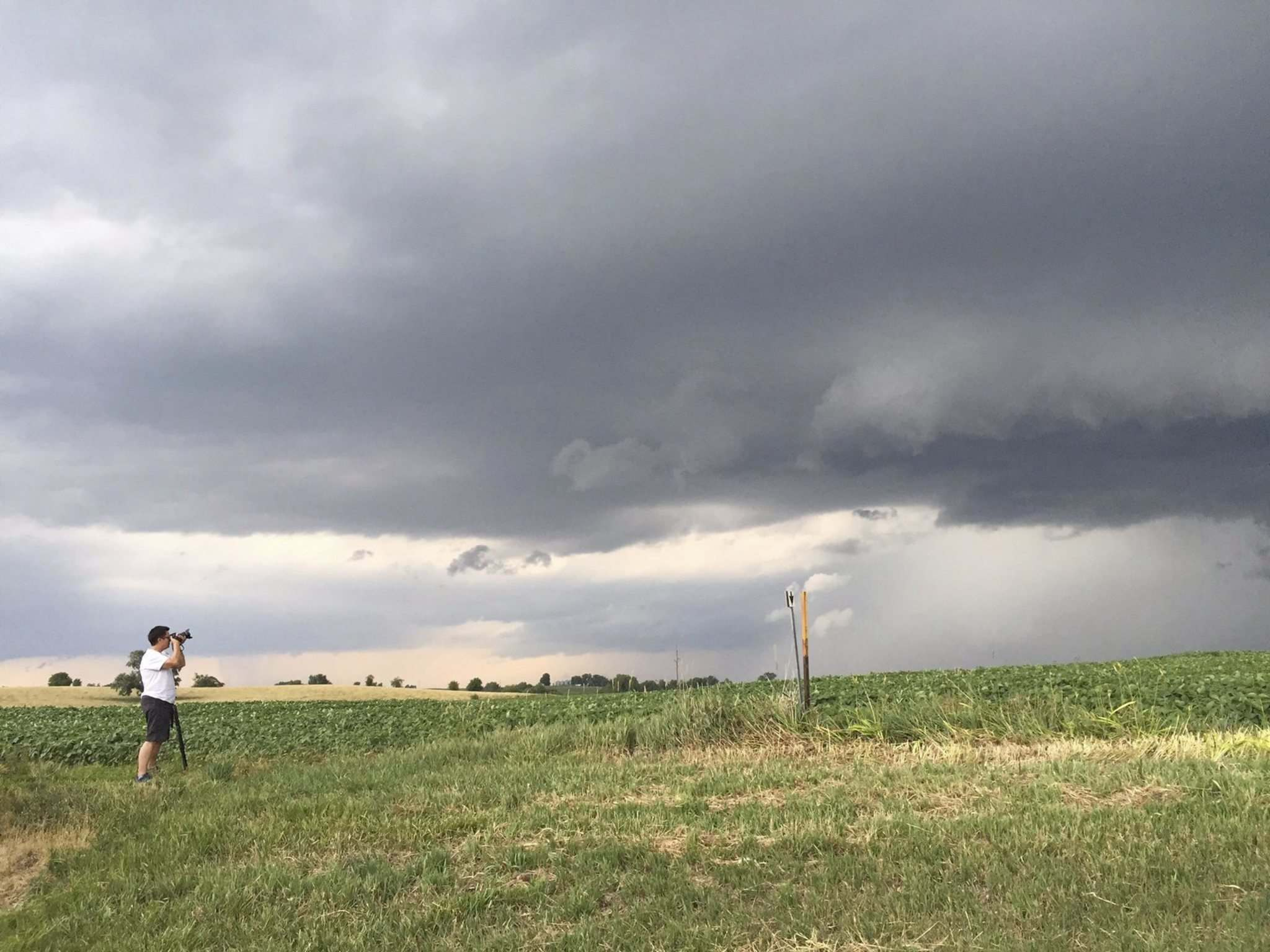 Nicole Loeb photo</p><p>Judy Wilson takes pictures of the storm south of Maryville, IA.</p>