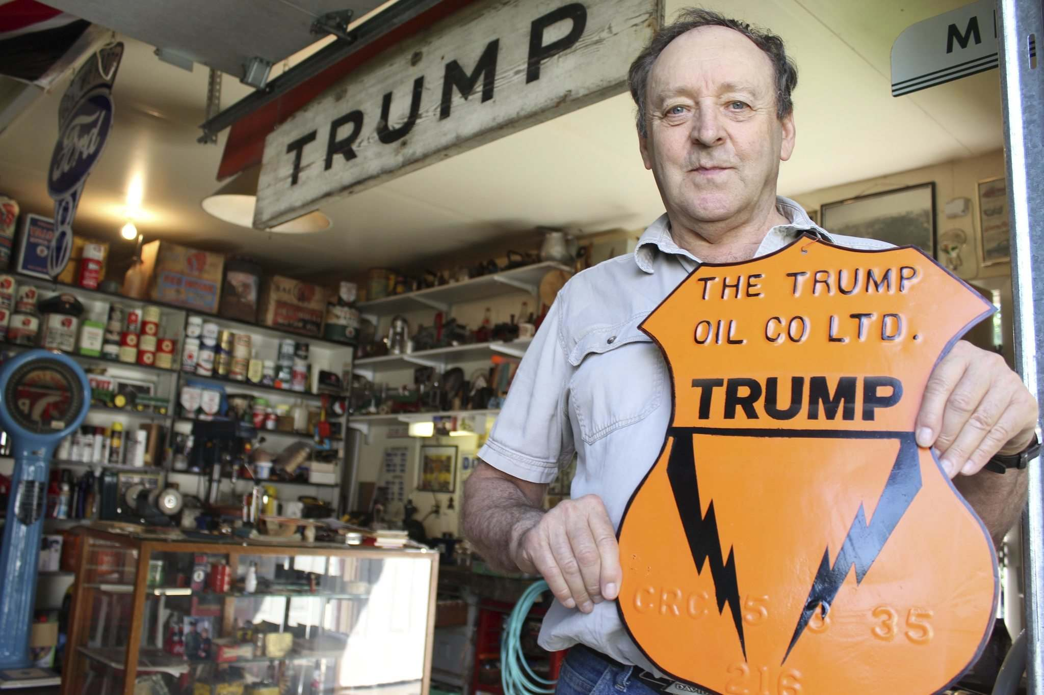 Photos by BILL REDEKOP / WINNIPEG FREE PRESS</p><p>Harvey Thiessen, who collects petroliana (gas station memorabilia), poses with a Trump Oil sign. At right is a Red Indian oil display.</p>