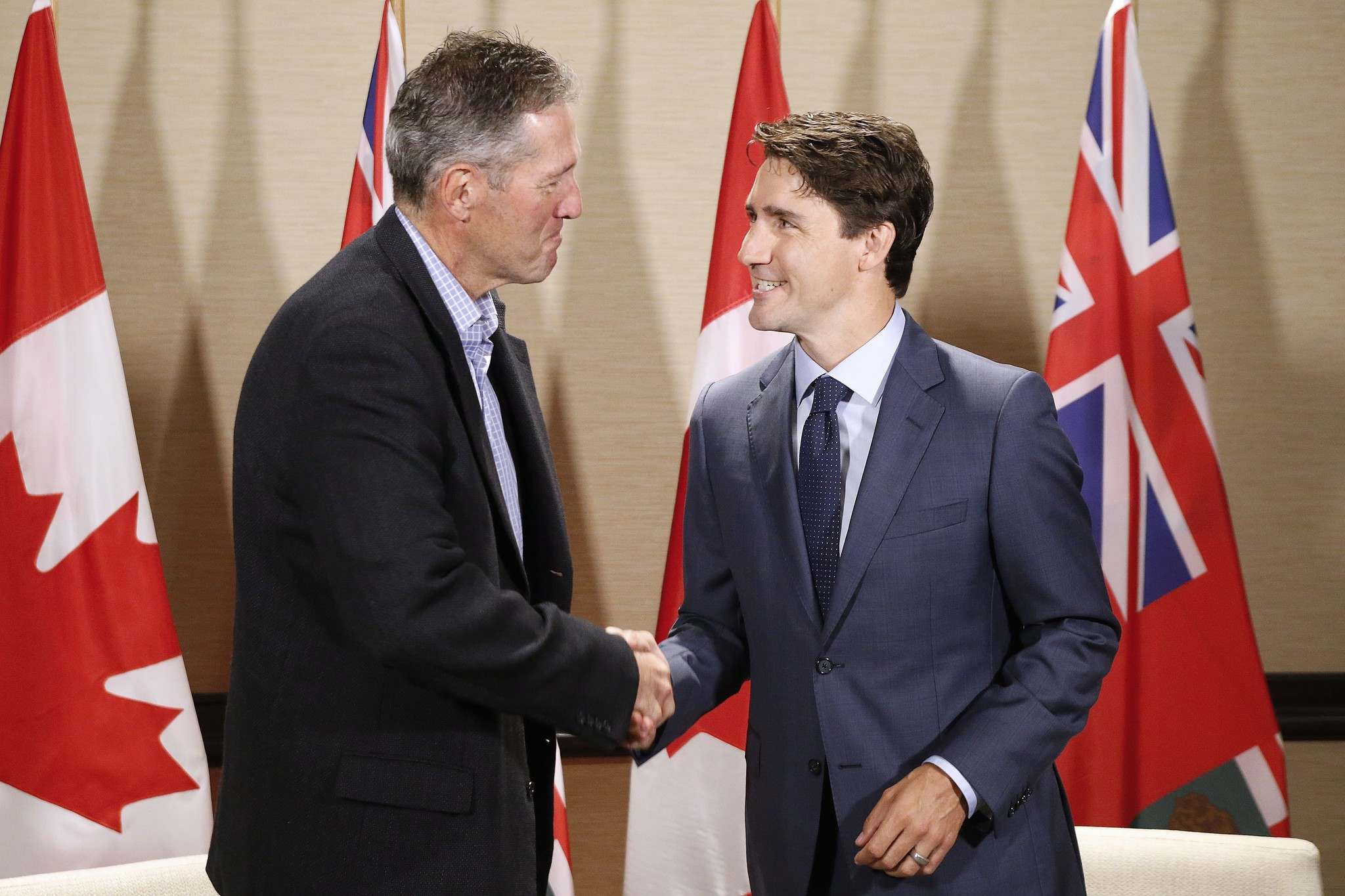 Prime Minister Justin Trudeau meets with Manitoba Premier Brian Pallister in Winnipeg on Saturday, July 29, 2017. THE CANADIAN PRESS/John Woods</p>