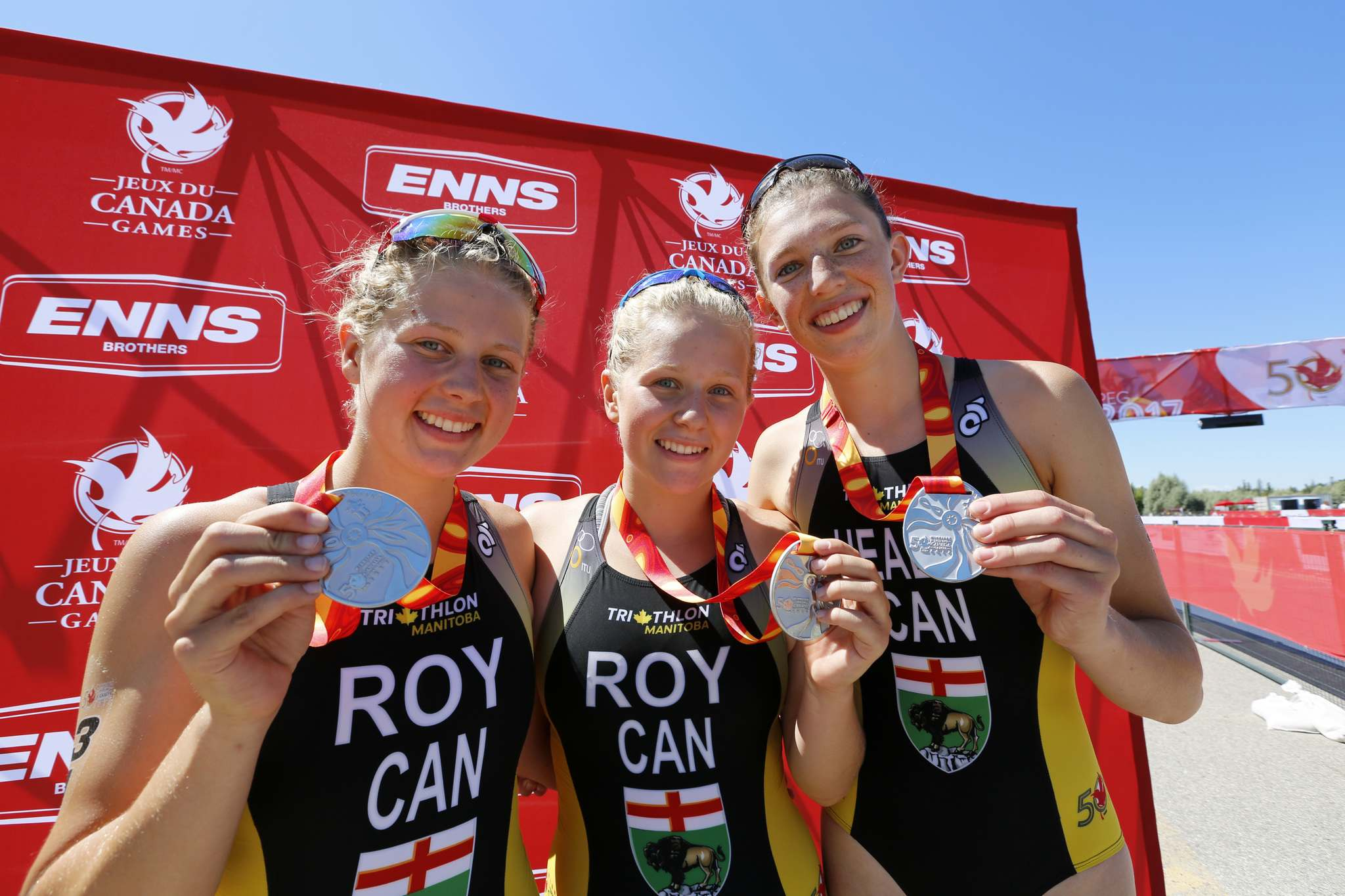 JUSTIN SAMANSKI-LANGILLE / WINNIPEG FREE PRESS</p><p>Team Manitoba's women's triathlon relay team Kyla Roy, Caitlyn Roy and Claire Healey pose with their silver medals Thursday at Birds Hill Provincial Park.</p>
