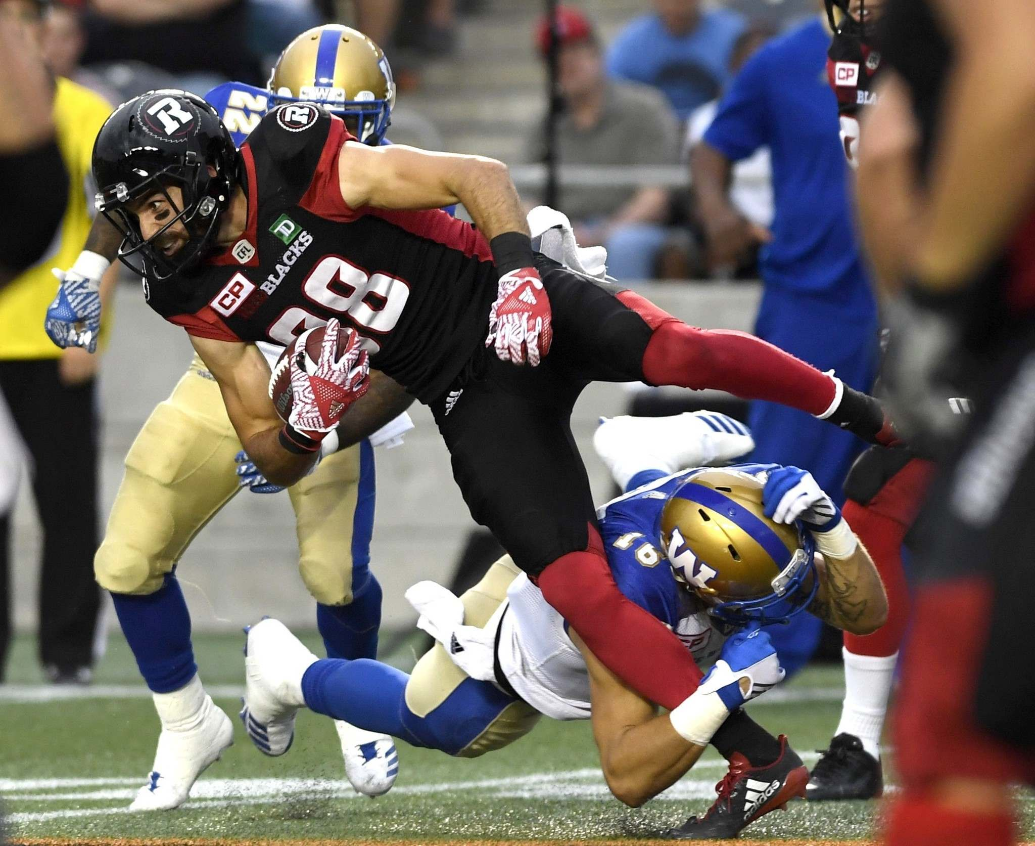 Bombers safety Taylor Loffler brings down Ottawa Redblacks receiver Brad Sinopoli on Friday.
