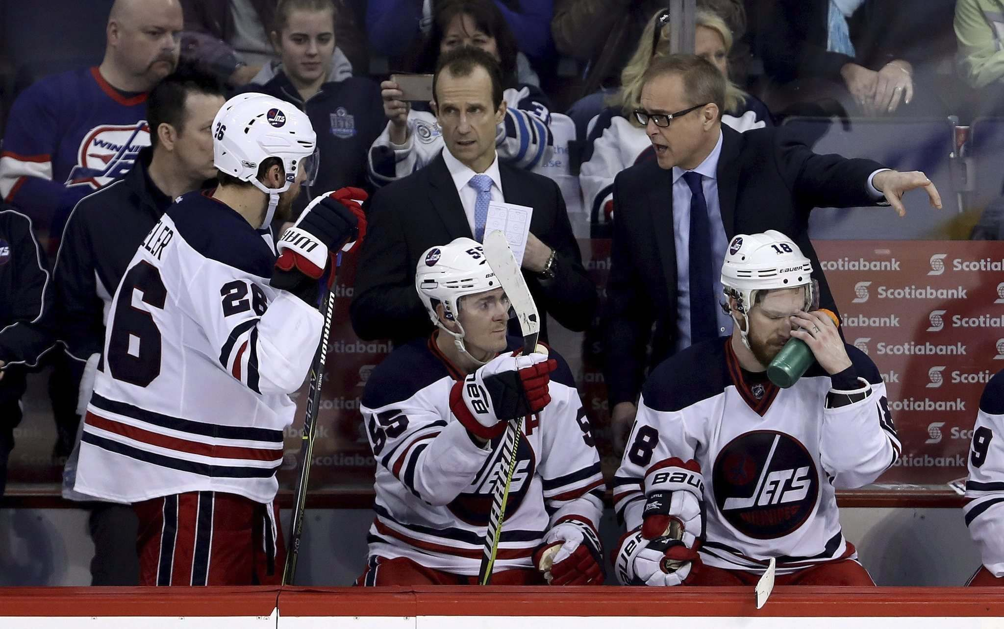 Winnipeg Jets' head coach Paul Maurice gives instructions to Blake Wheeler (26) while playing against the Minnesota Wild during third period NHL hockey action in Winnipeg, Sunday, March 19, 2017.