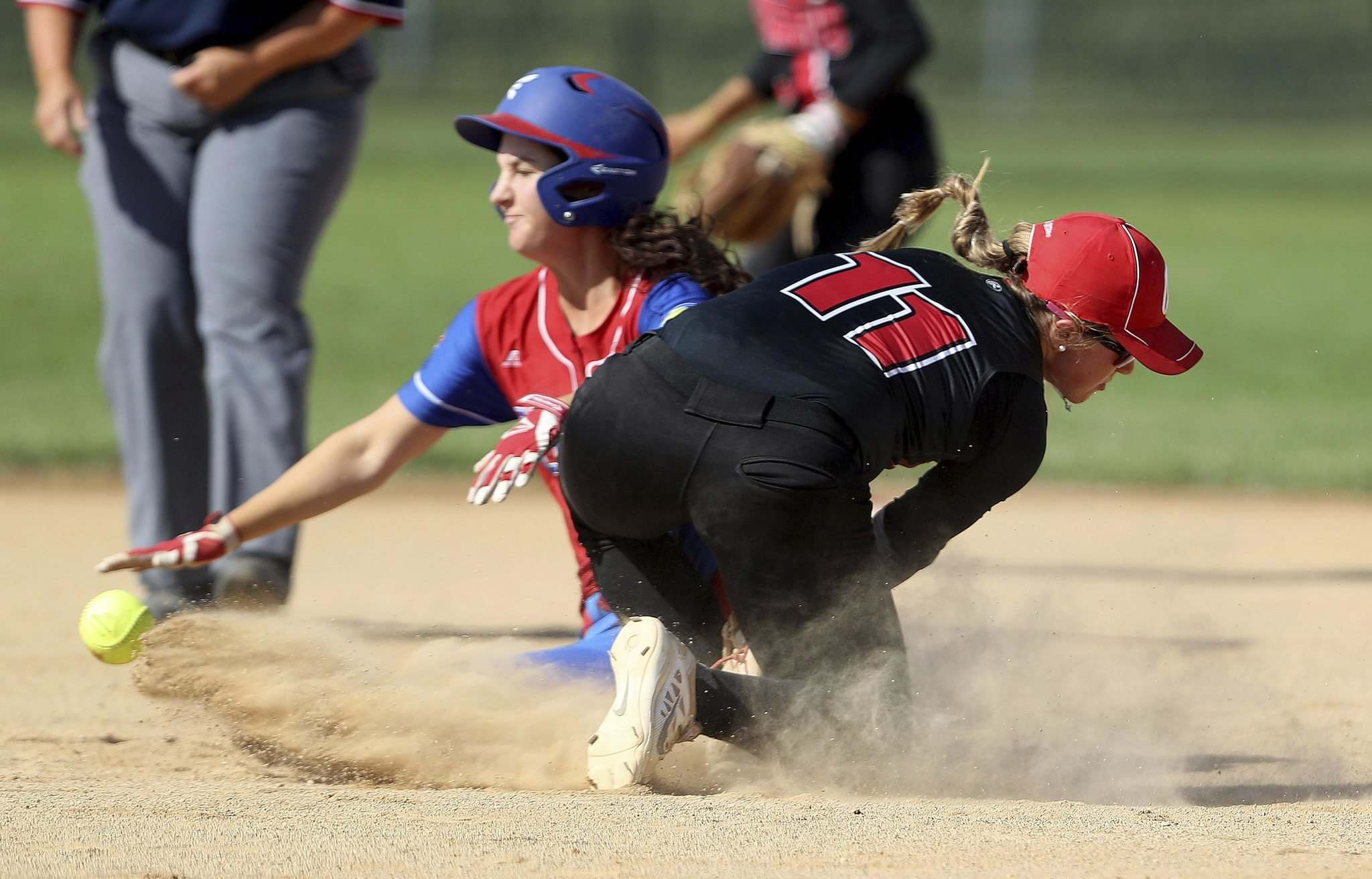 TREVOR HAGAN / WINNIPEG FREE PRESS</p><p>British Columbia's Taylor Lundrigan (left) crashes into Ontario's Courtney Gilbert as she slides into second base during girls softball action Saturday at the Canada Summer Games.</p>