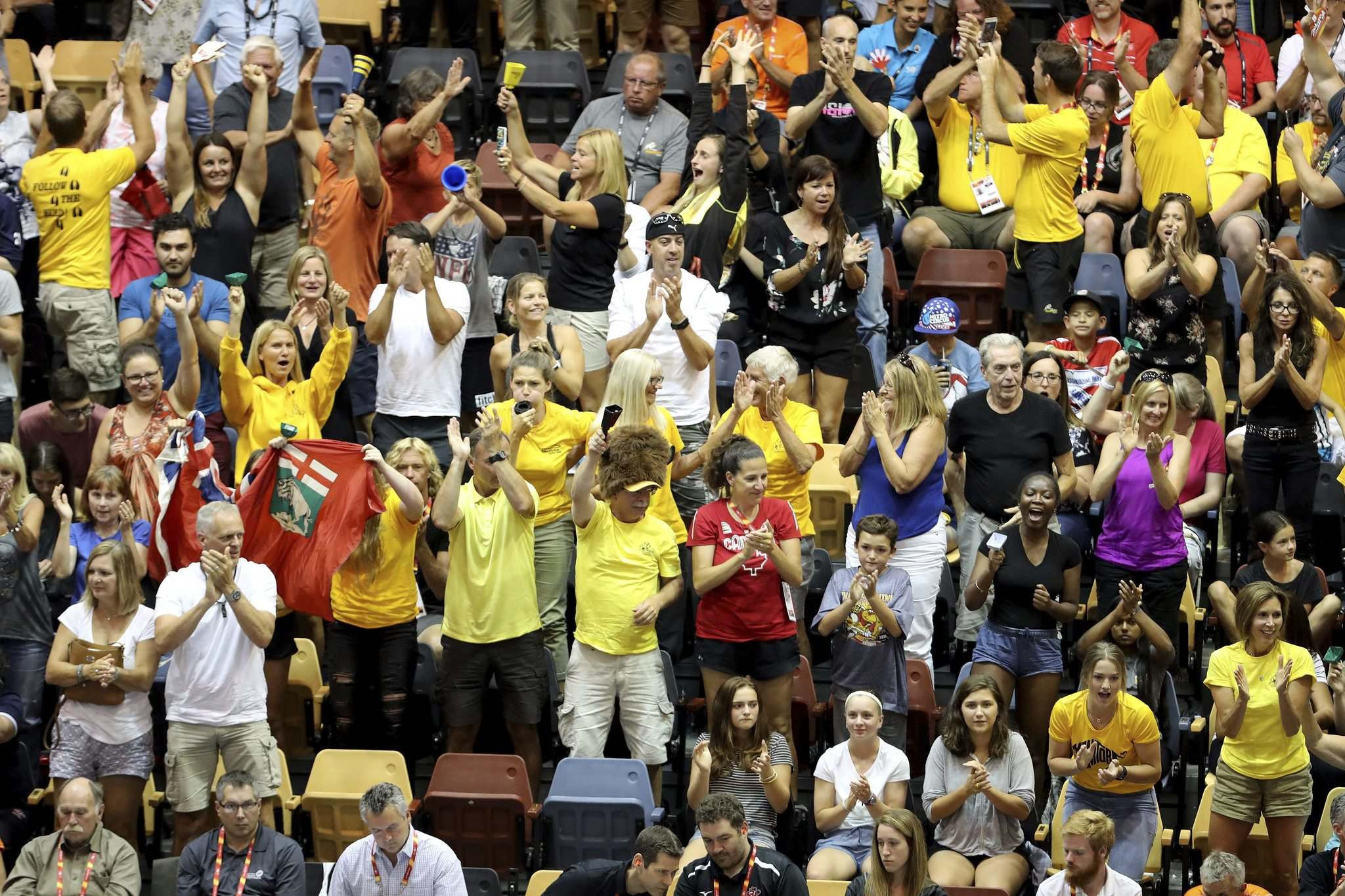 TREVOR HAGAN / WINNIPEG FREE PRESS</p><p>Team Manitoba fans celebrate after winning a point on the way to taking volleyball gold.</p>