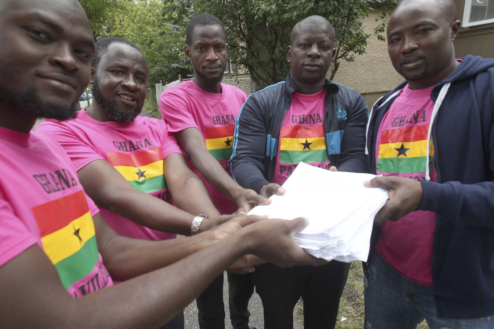 JOE BRYKSA / WINNIPEG FREE PRESS</p><p>From left, Fuseini Umar, Saalu Usman, Ziyawu Mohammed, Sulemana Abdulai, and Baba Issaka are LGBTQ* refugee claimants from Ghana with signatures they collected outside Folklorama pavilions calling for the decriminalization of homosexuality in Ghana.</p>