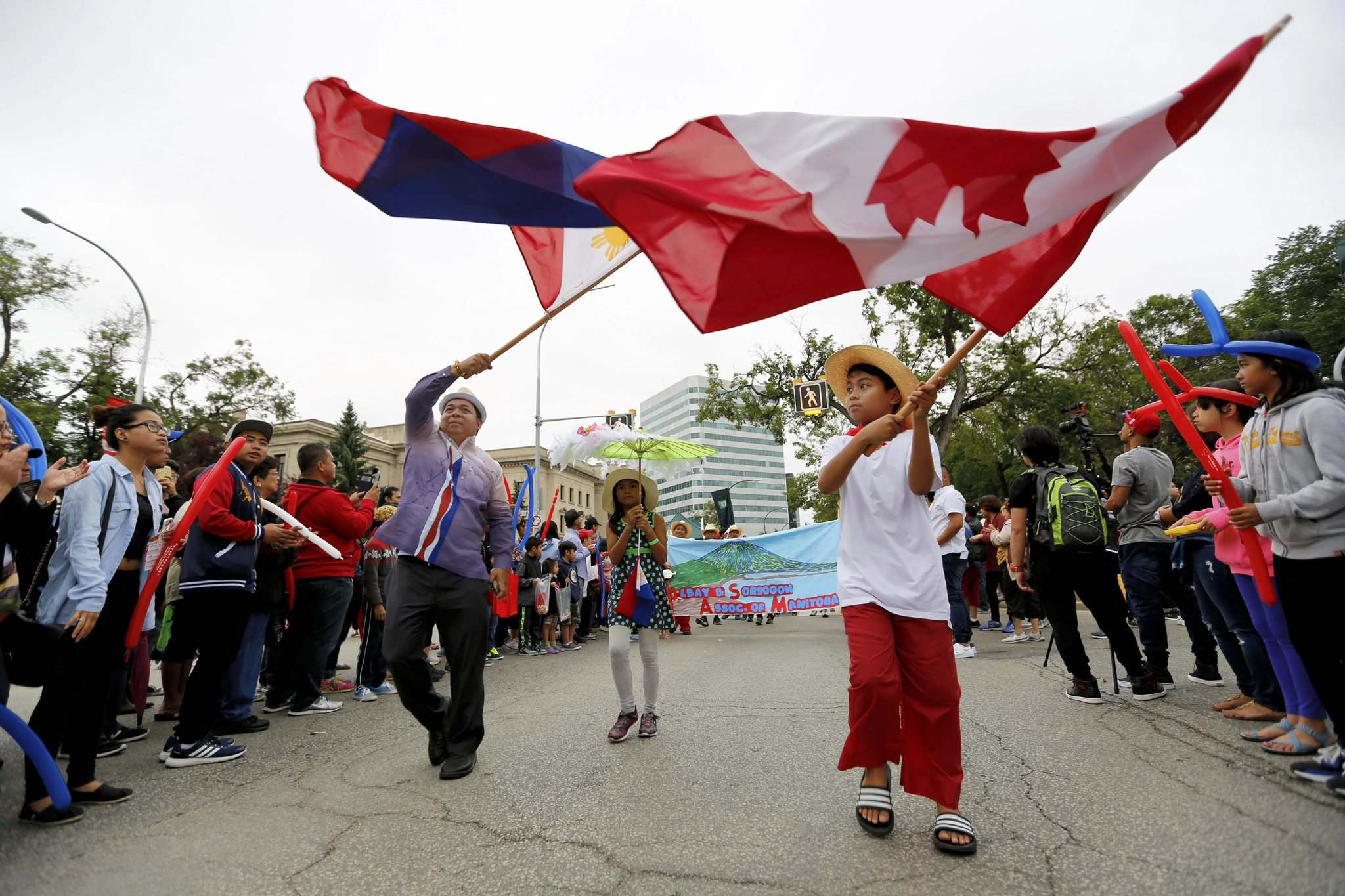 PHOTOS BY JUSTIN SAMANSKI-LANGILLE / WINNIPEG FREE PRESS</p><p>Downtown streets were alive Saturday as members of Manitoba's Filipino community joined together to take part in the Manitoba Filipino Street Festival.</p>
