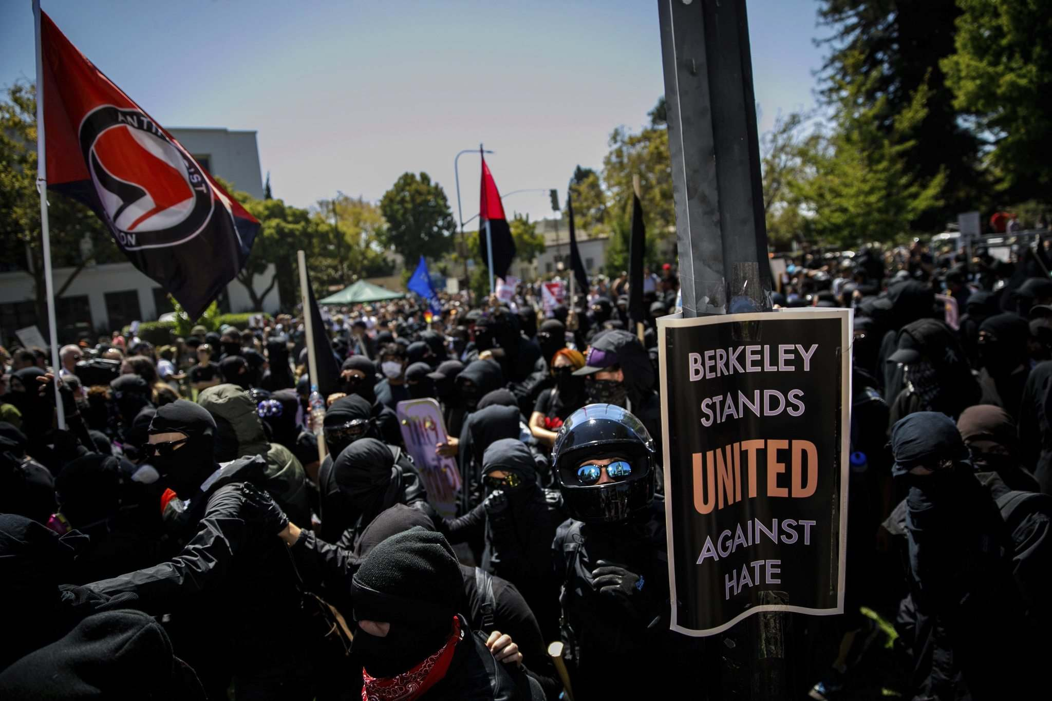 Marcus Yam / Los Angeles Times</p><p>Members of the black bloc march into Martin Luther King Park after police officers retreated during a day full of protests in Berkeley, Calif., on Aug. 27.</p>