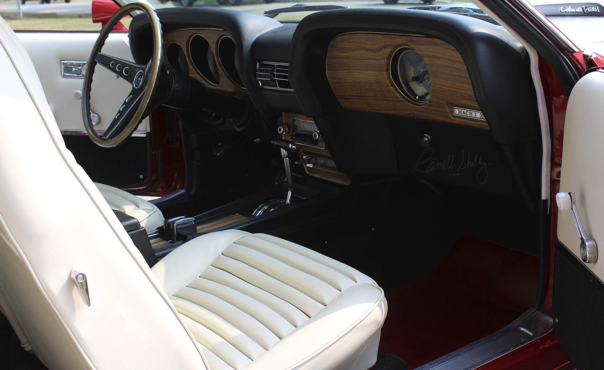 Larry D'ArgisThe interior features white Clarion knit vinyl upholstery.