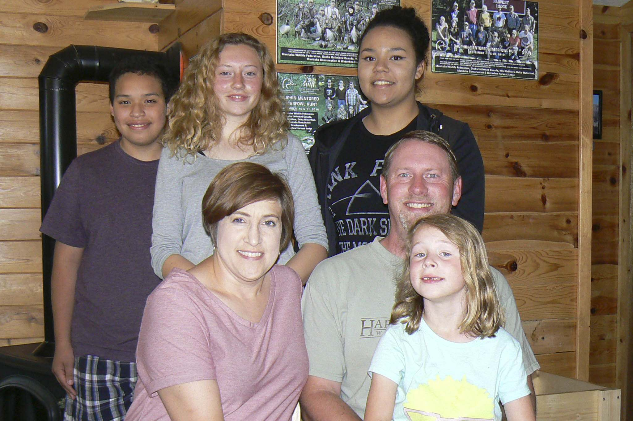 SUPPLIED</p><p>Karissa and Jon Warkentin and four of their children at their lodge in Waterhen. Karalynn, six, (bottom right) was deemed medically inadmissible earlier this year, but the government has given the family a chance to reapply for permanent residency.</p>