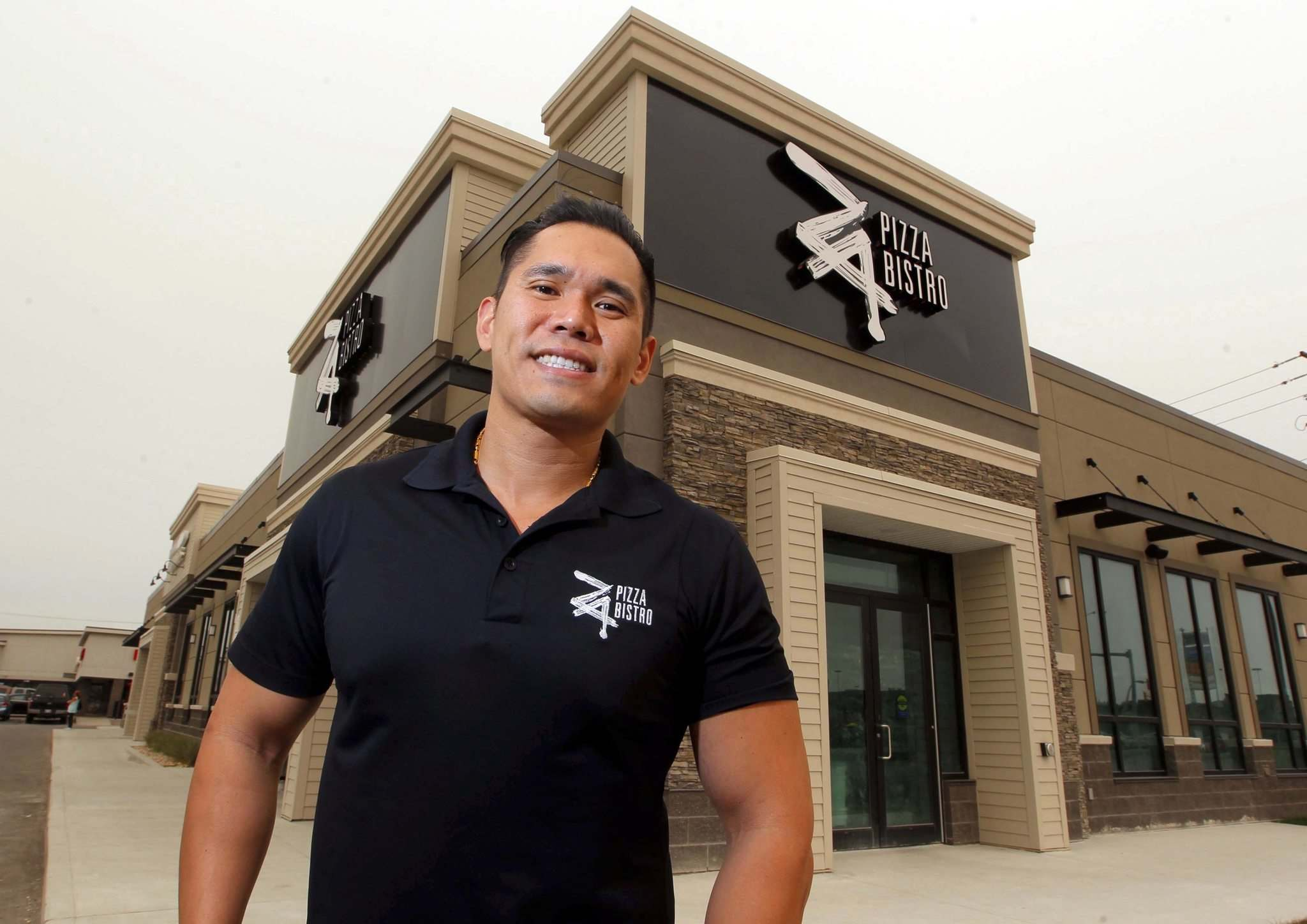 BORIS MINKEVICH / WINNIPEG FREE PRESS</p><p>Manly Cheung, the founder of Za Pizza Bistro, is outside the new flagship location at 1573 Regent Ave. West., set to open in the first week of October.</p></p>