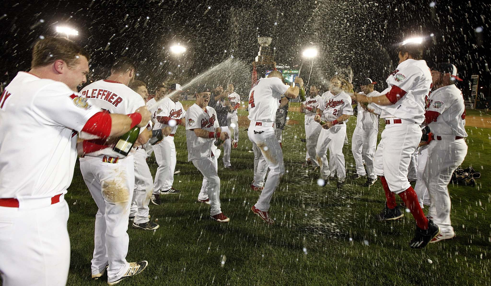 Winnipeg Goldeyes enjoy a champagne shower after taking the American Association Championship over the Wichita Wingnuts.</p>