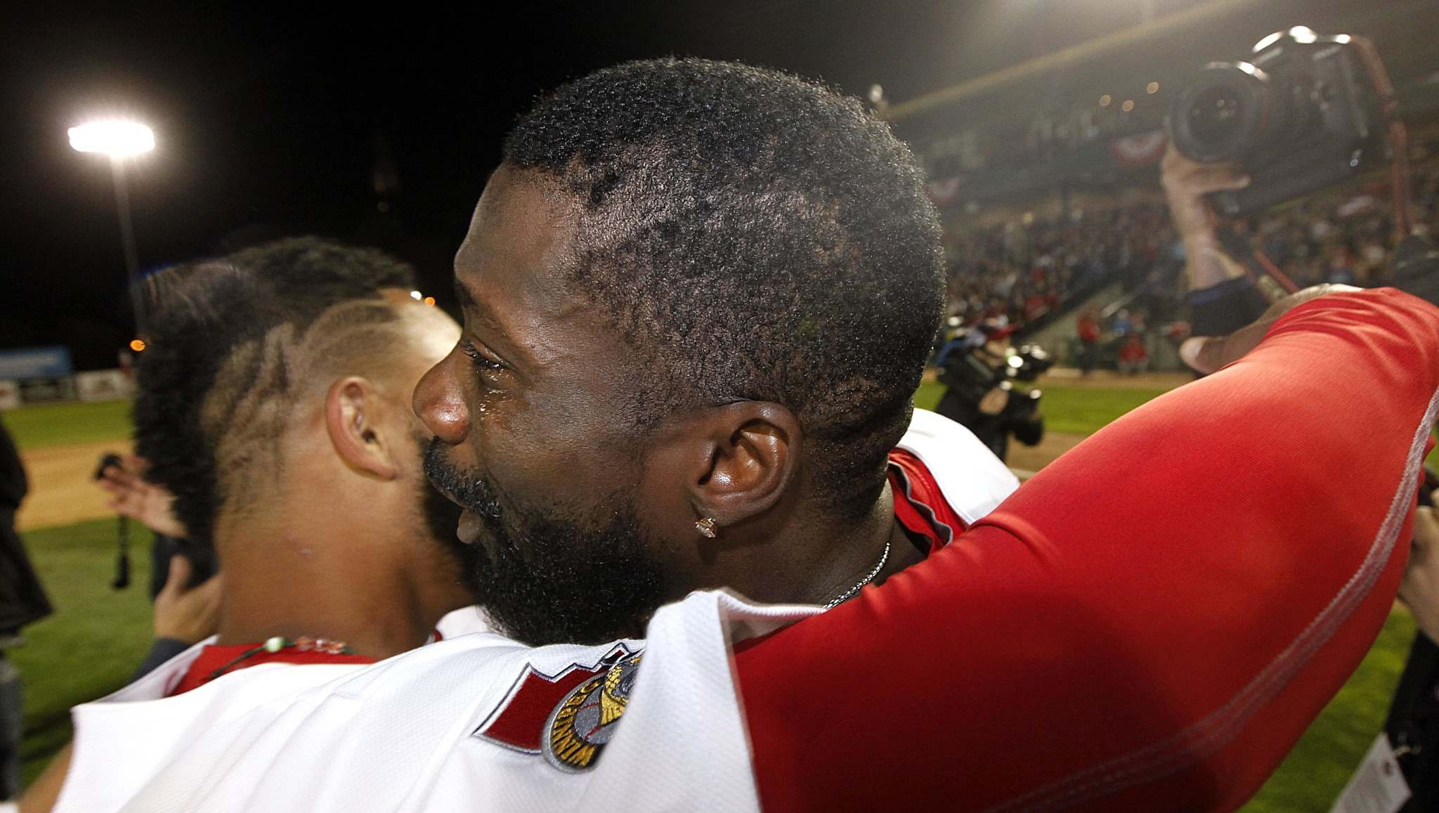 A teary eyed Reggie Abercrombie embraces teammate Victor Capellan after the Winnipeg Goldeyes took the American Association Championship over the Wichita Wingnuts in September. (Phil Hossack / Winnipeg Free Press files)</p></p>