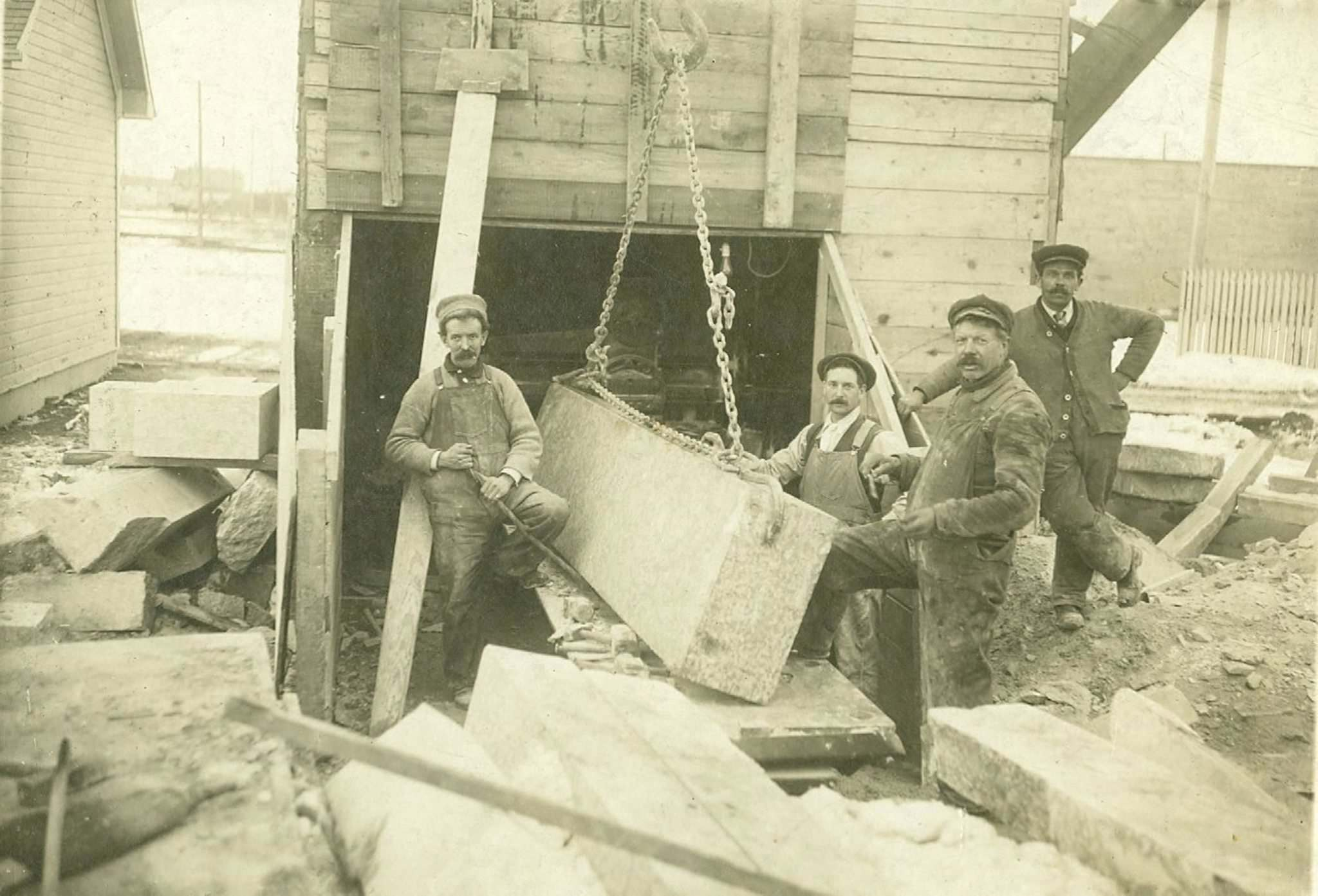 GILLIS QUARRIES LIMITED ARCHIVES</p><p>August Gillis, founder of Gillis Quarries, second from right.</p>