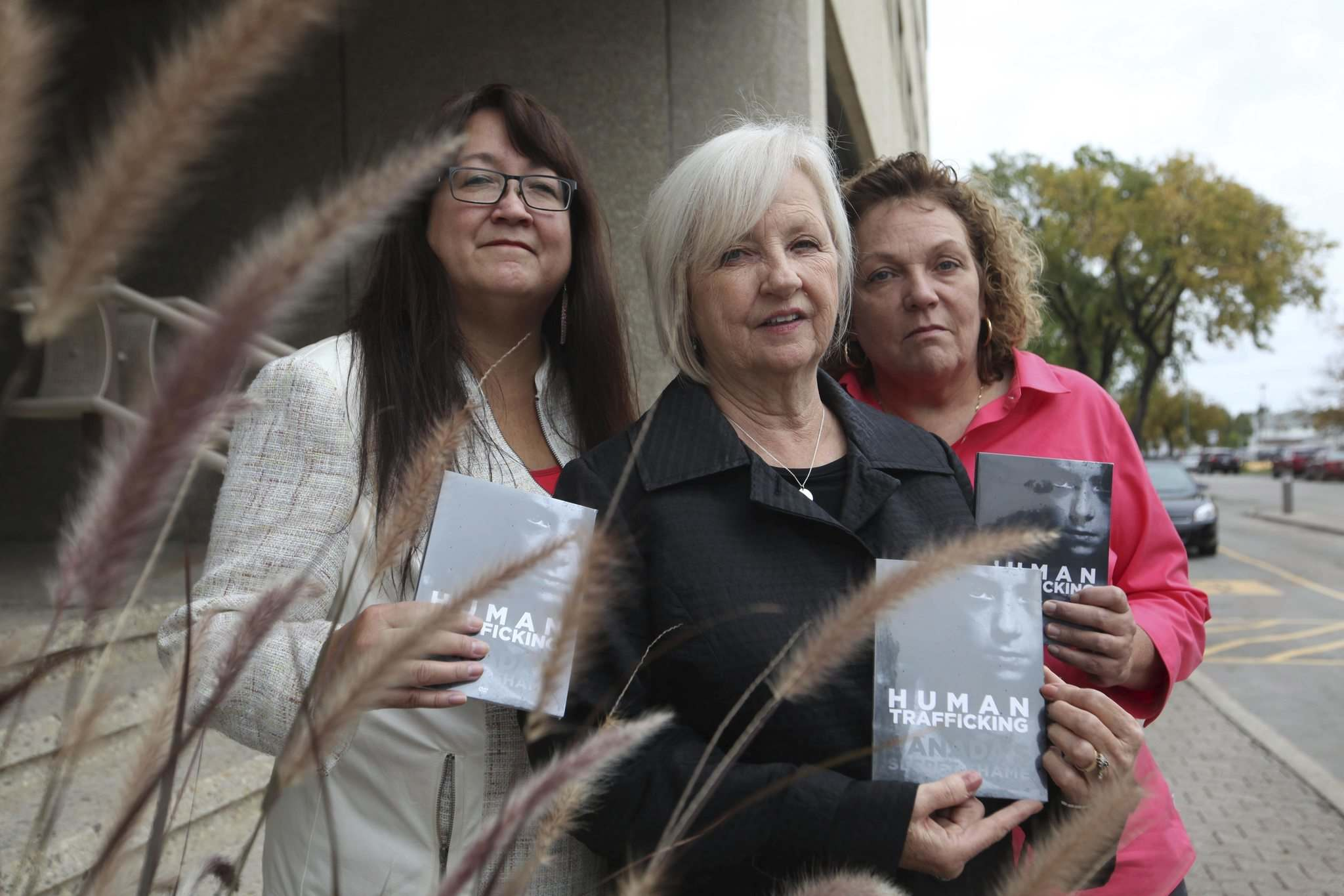 RUTH BONNEVILLE / WINNIPEG FREE PRESS</p><p>Joy Smith, founder of the Joy Smith Foundation and former Member of Parliament (centre) along with Diane Redsky, Executive Director of Ma Mawi Wi Chi Itata Centre (left) and Shona Stewart Director of Dignity House (which helps sexually exploited women), in Winnipeg after the launch of a documentary on Human Trafficking; Canada's Secret Shame produced by the Joy Smith Foundation Monday. </p>