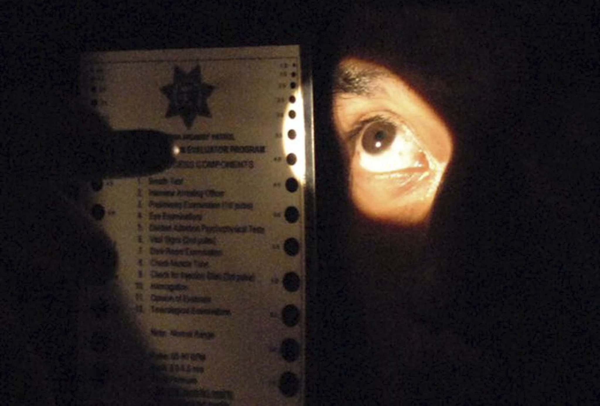 Joe McHugh / California Highway Patrol</p><p>Officers who are trained as Drug Recognition Evaluators perform darkroom examinations of the eyes looking for signs of drug impairment. These examinations include measuring the size of the pupil in direct light and in near total darkness. Officers also observe the reactions of the pupil under these extreme conditions.</p>