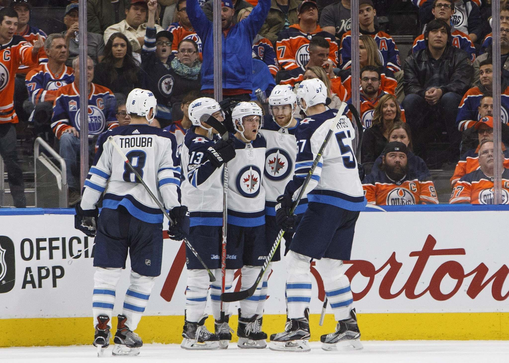 JASON FRANSON / THE CANADIAN PRESS</p><p>Winnipeg Jet Nikolaj Ehlers (27) celebrates his goal with teammates Jacob Trouba (8), Brandon Tanev (13), Adam Lowry (17) and Tyler Myers (57) during second-period NHL action against the Edmonton Oilers in Edmonton Monday.</p>