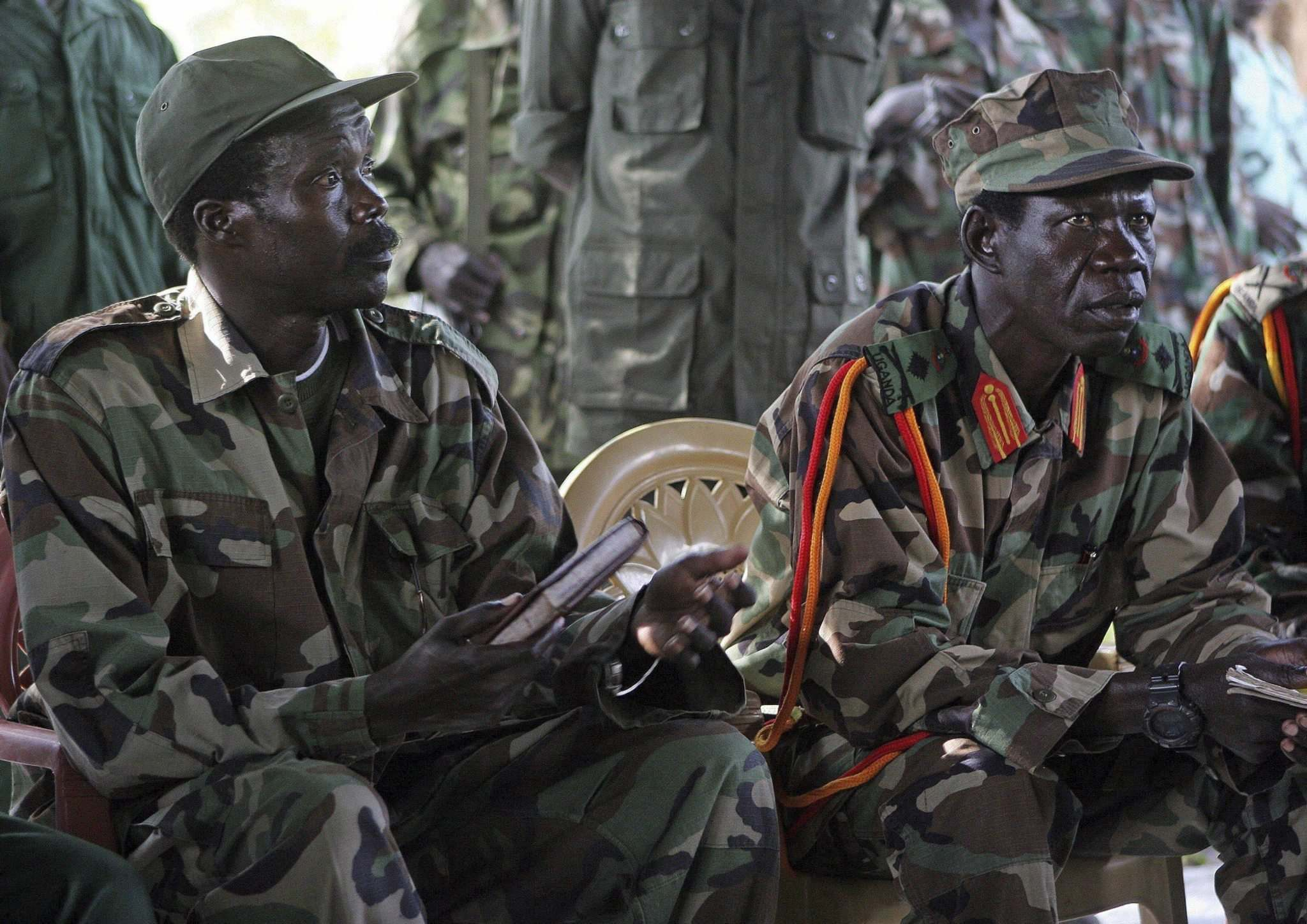 Stuart Price / The Associated Press files</p><p>In this 2006 photo, Joseph Kony (left), leader of the Lord's Resistance Army, and his deputy Vincent Otti sit inside a tent at Ri-Kwamba in southern Sudan.</p>