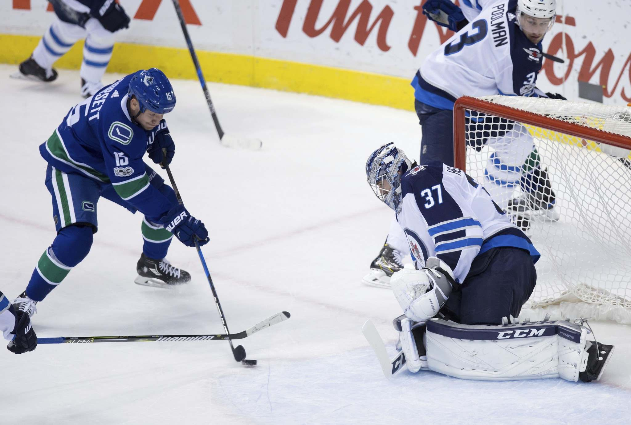 THE CANADIAN PRESS/Darryl Dyck</p><p>Vancouver Canucks&#39; Derek Dorsett, left, is stopped by Winnipeg Jets&#39; goalie Connor Hellebuyck who had 31 saves on the night. </p>