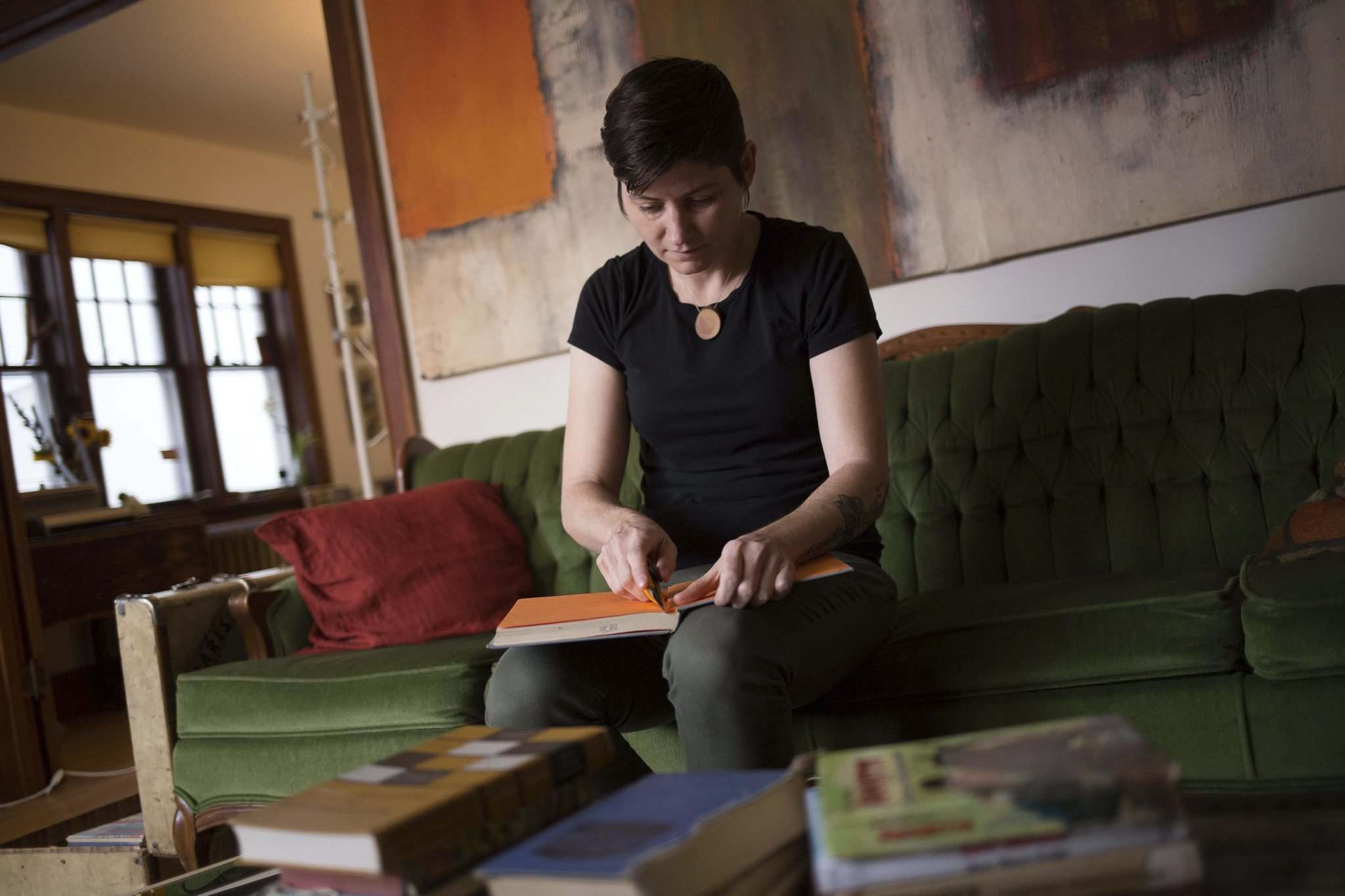 JEN DOERKSEN/WINNIPEG FREE PRESS</p><p>Julie Epp makes journals from old books. She starts by cutting off the front and back covers, and any pages inside that she will use for decoration.