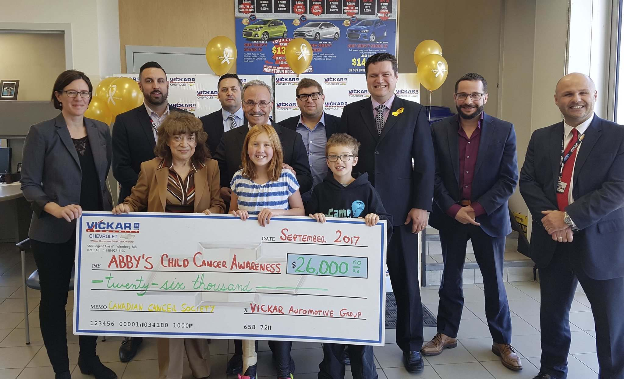 On Oct. 11 the Vickar Automotive Group presented a cheque for $26,000 to Abby Stewart and the Canadian Cancer Society.Pictured from left to right: Erin Crawford from the Canadian Cancer Society, Ryan Pasternik, Tova Vickar, Tim Penner, Larry Vickar, Abby Stewart, Stephen Vickar, Zachary Stewart, James Teitsma, Sam Vickar and Domenic Sacco.