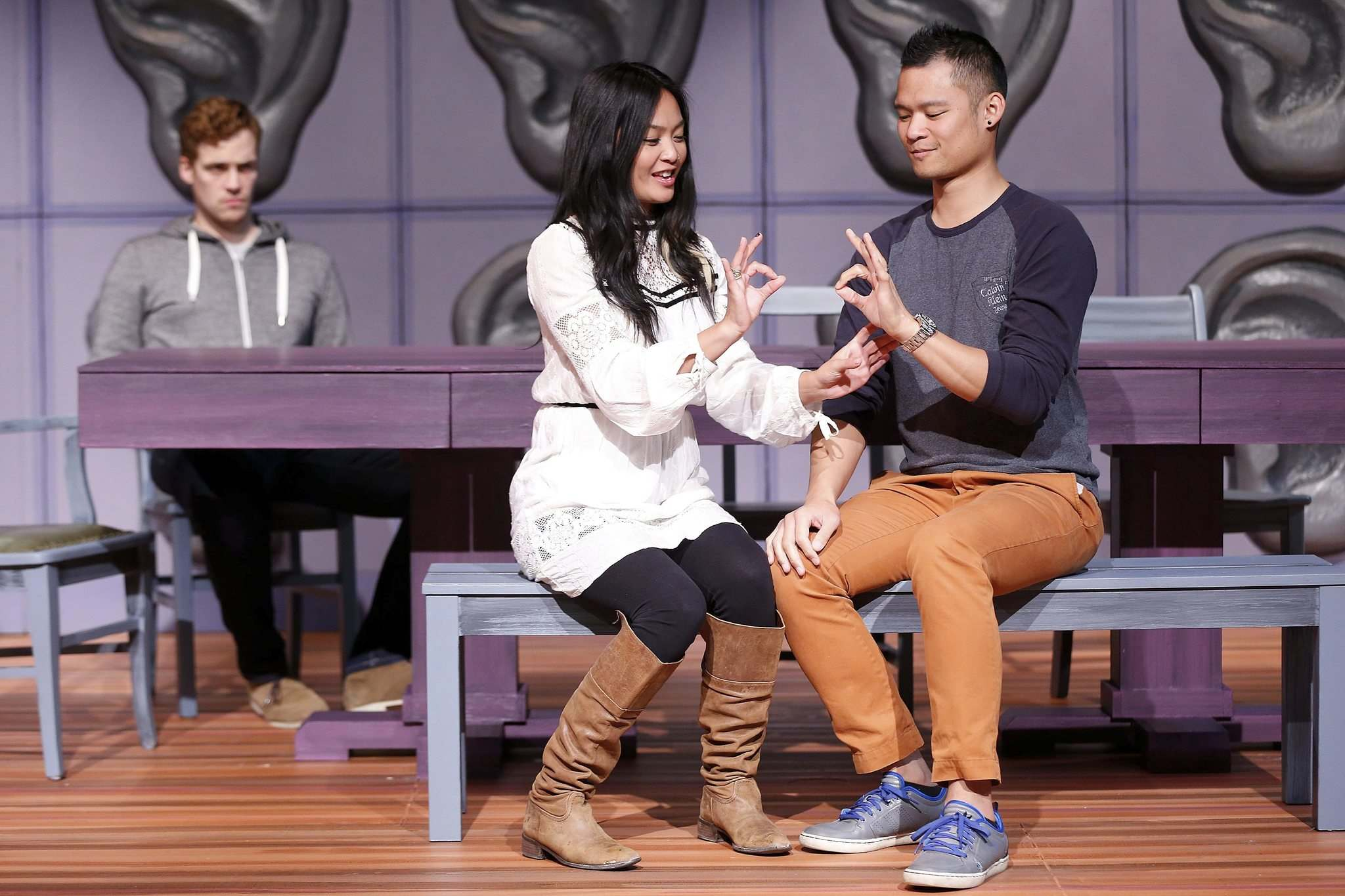 JOHN WOODS / WINNIPEG FREE PRESS</p><p>Stephanie Sy assists Jordan Sangalang (right) with his sign language as Ryan James Miller looks on during rehearsal of Winnipeg Jewish Theatre's Tribes.</p>