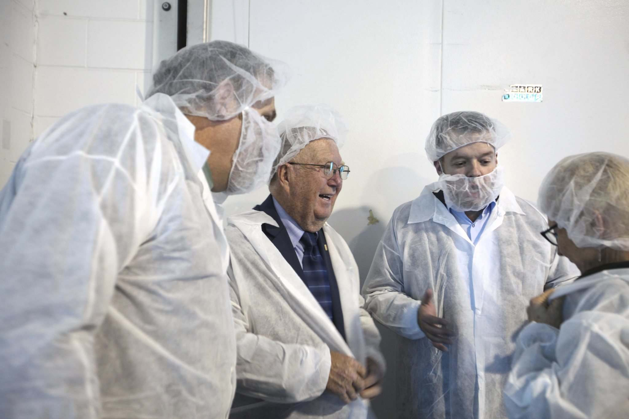 <p>Manitoba Agriculture Minister Ralph Eichler, left and Vitalus Nutrition Inc. president and CEO Philip Vanderpol, centre put on protective clothing for a plant tour of the new $100-million dairy processing plant in Winnipeg Wednesday.</p>