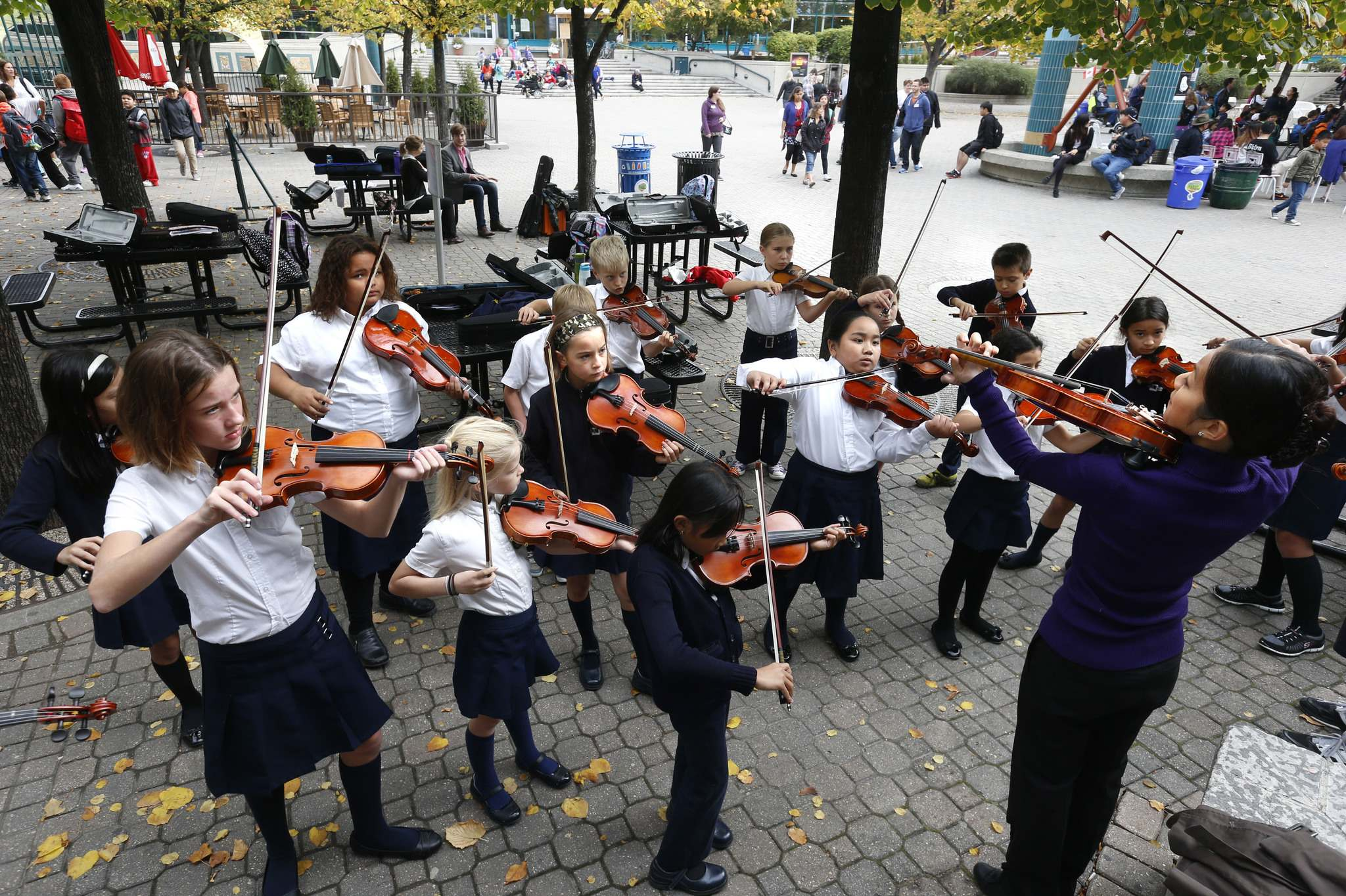 The St.Charles Catholic School&rsquo;s Junior Violin Ambassadors warm up with their music teacher Rachel Sham before hitting the stage at Manitoba&rsquo;s Culture Daysin 2015. (Wayne Glowacki / Winnipeg Free Press files)</p>