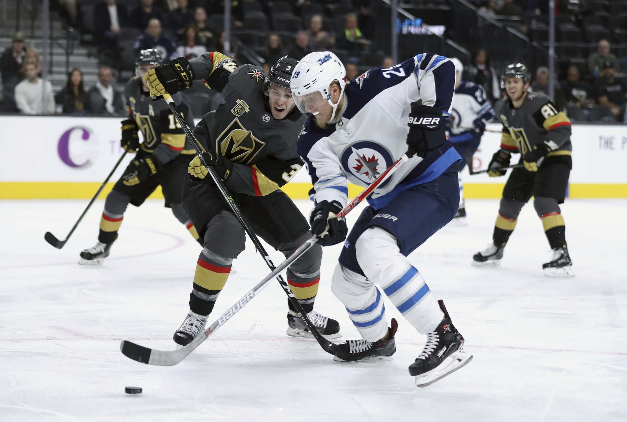 <p>Vegas Golden Knights&#39; Brayden McNabb and Winnipeg Jets&#39; Patrik Laine during first period NHL action at T-Mobile Arena, in Las Vegas, Friday, November 10, 2017.</p>