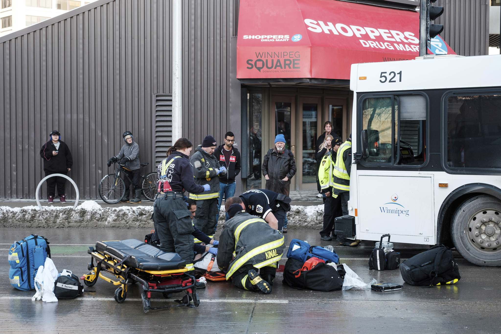 Daniel Crump / Winnipeg Free Press</p><p>First responders work on a man who was struck by a Winnipeg Transit bus at the corner of Graham Avenue and Fort Street Monday night.</p>