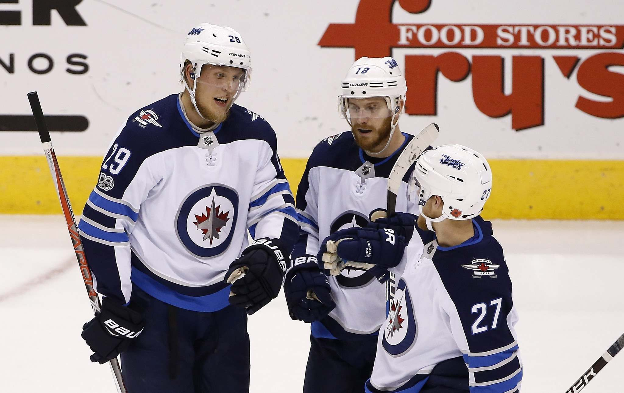 Winnipeg Jets right wing Patrik Laine (29) celebrates his empty net goal against the Arizona Coyotes with Jets left wing Nikolaj Ehlers (27) and Jets center Bryan Little (18) during the third period of an NHL hockey game Saturday, Nov. 11, 2017, in Glendale, Ariz. The Jets defeated the Coyotes 4-1. (AP Photo/Ross D. Franklin)</p>