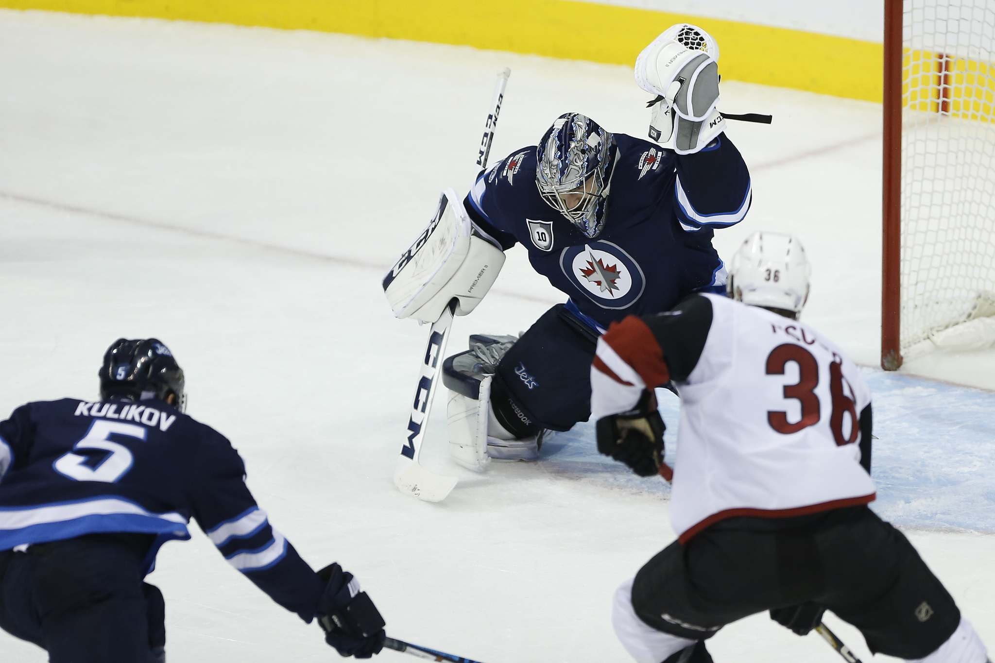 JOHN WOODS / WINNIPEG FREE PRESS</p><p>Winnipeg Jets goaltender Connor Hellebuyck robs Arizona Coyotes&#39; Derek Stepan as Christian Fischer looks for a rebound and Jets&#39; Dmitry Kulikov defends during second period NHL action in Winnipeg on Tuesday.</p>