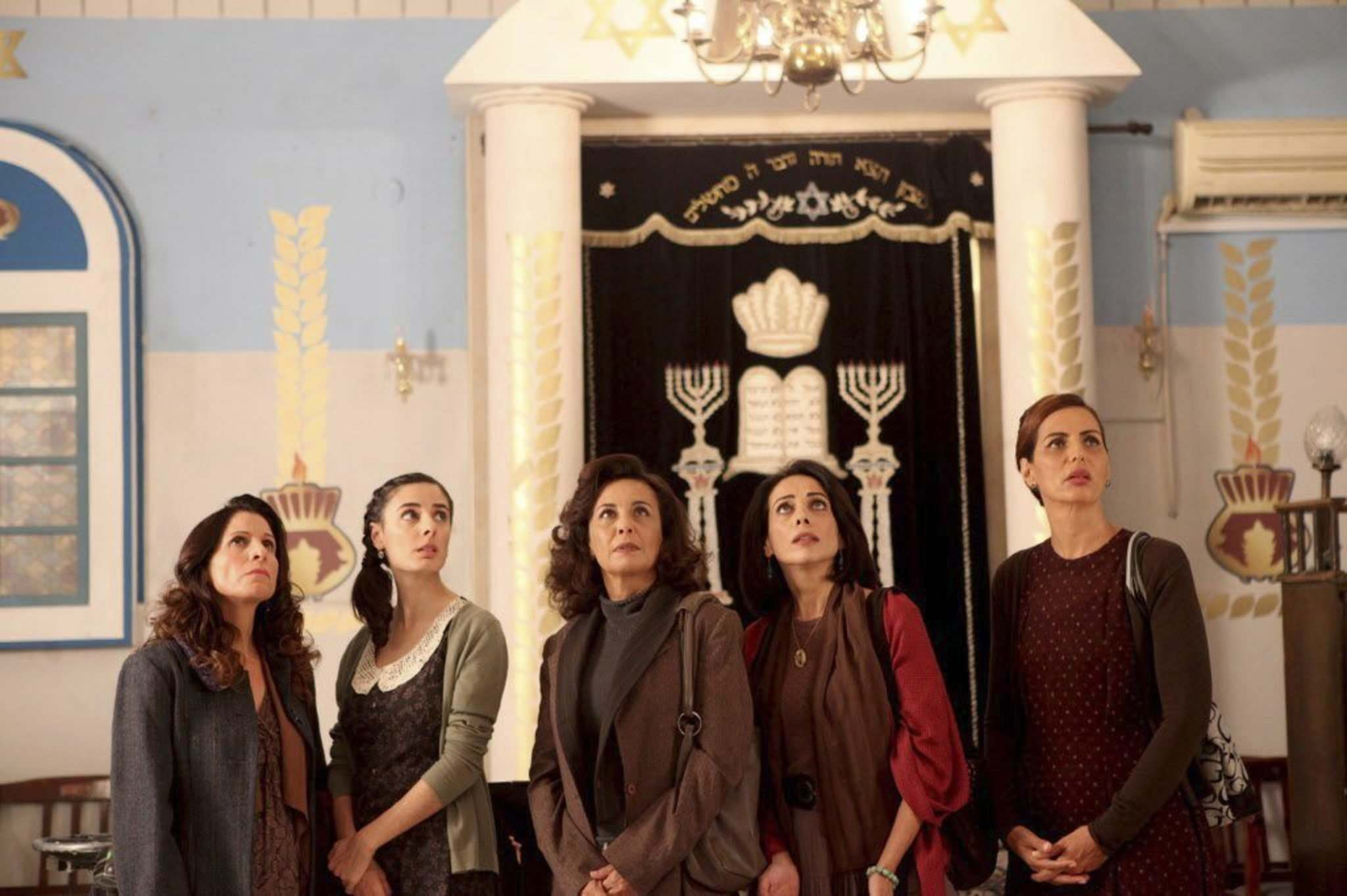 Menemsha Films</p><p>The wives in The Women's Balcony stage a strike, walking out on their husbands until the issue of a collapsed balcony at synagogue is resolved.</p></p>