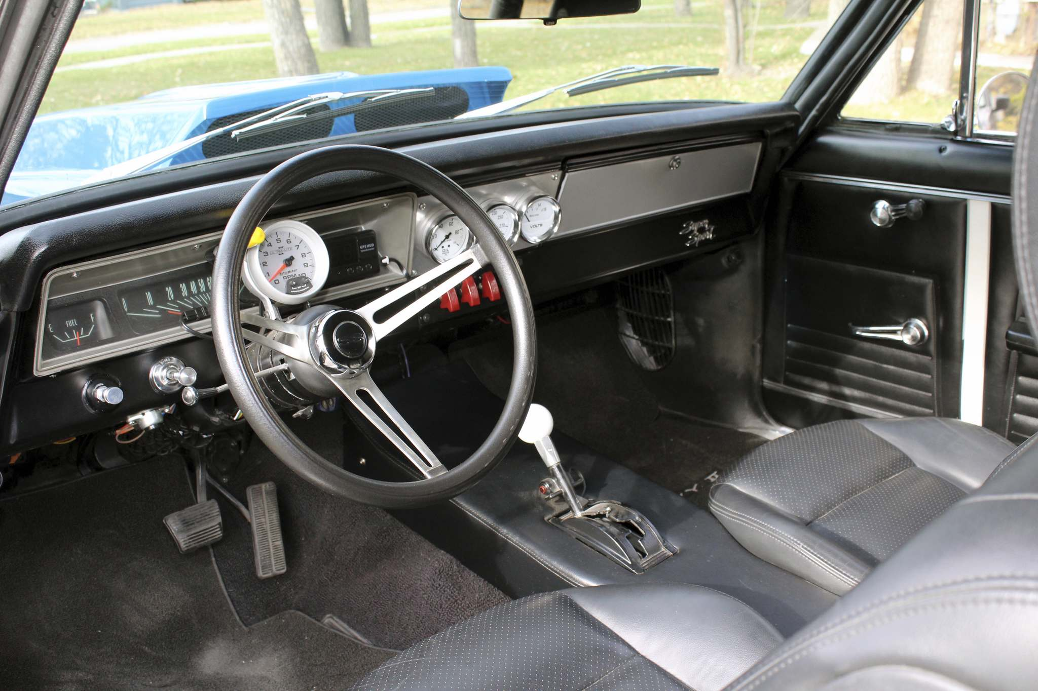 This 1967 score already had a black vinyl bucket seat interior with custom centre console and Autometer tachometer and gauge package.