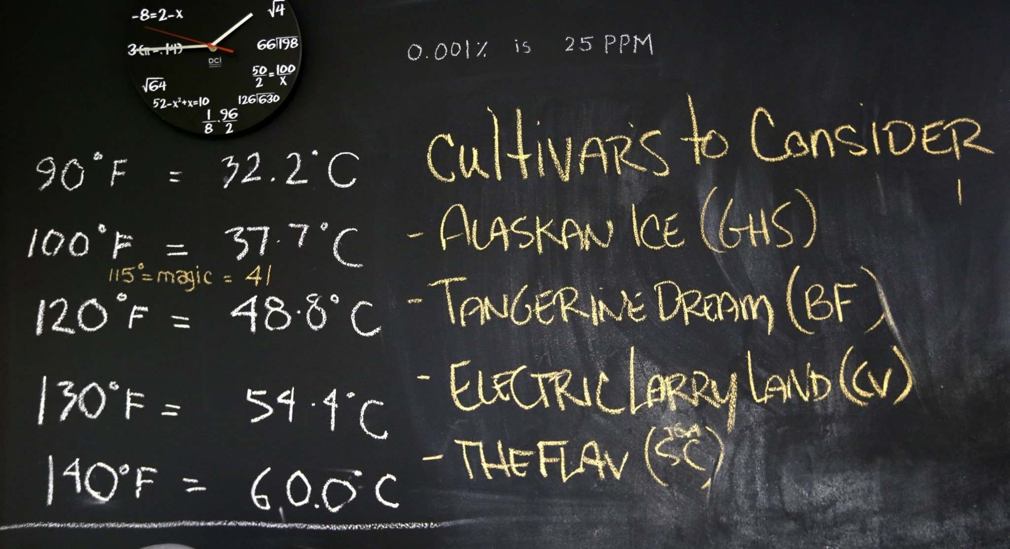 Marijuana cultivars are written on a chalkboard at a growing facility in Seattle. (Elaine Thompson / The Associated Press files)</p>