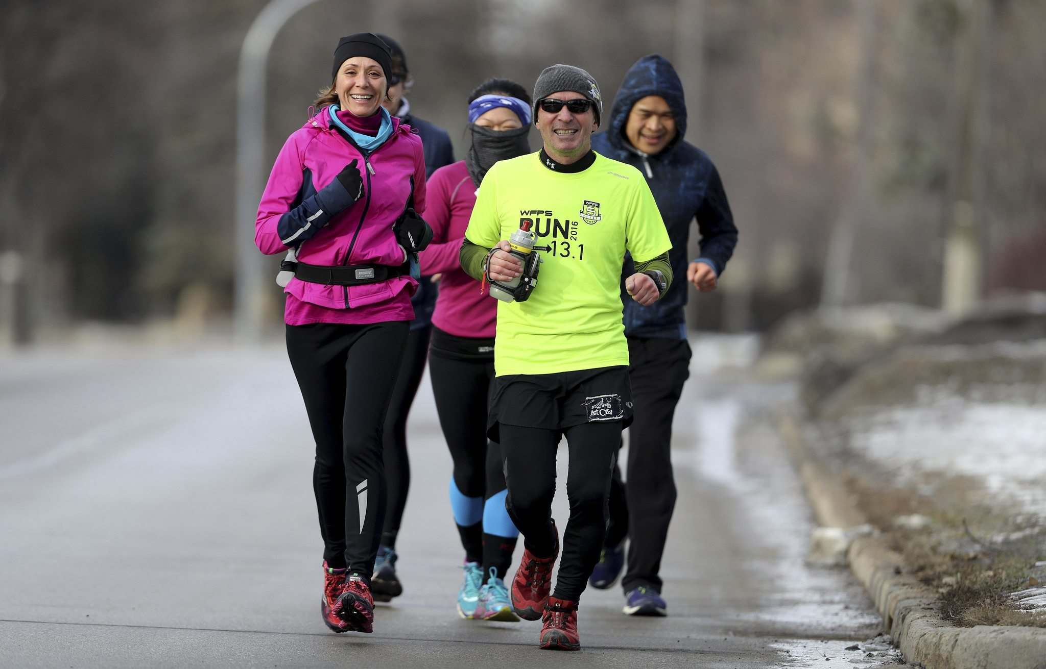 TREVOR HAGAN / WINNIPEG FREE PRESS</p><p>Retired teacher Mike Bennett (centre) ran 58.341 kilometres Sunday to raise funds for Art City. There are still some donations left to tally, but at last count, the total was $5,000.</p></p>
