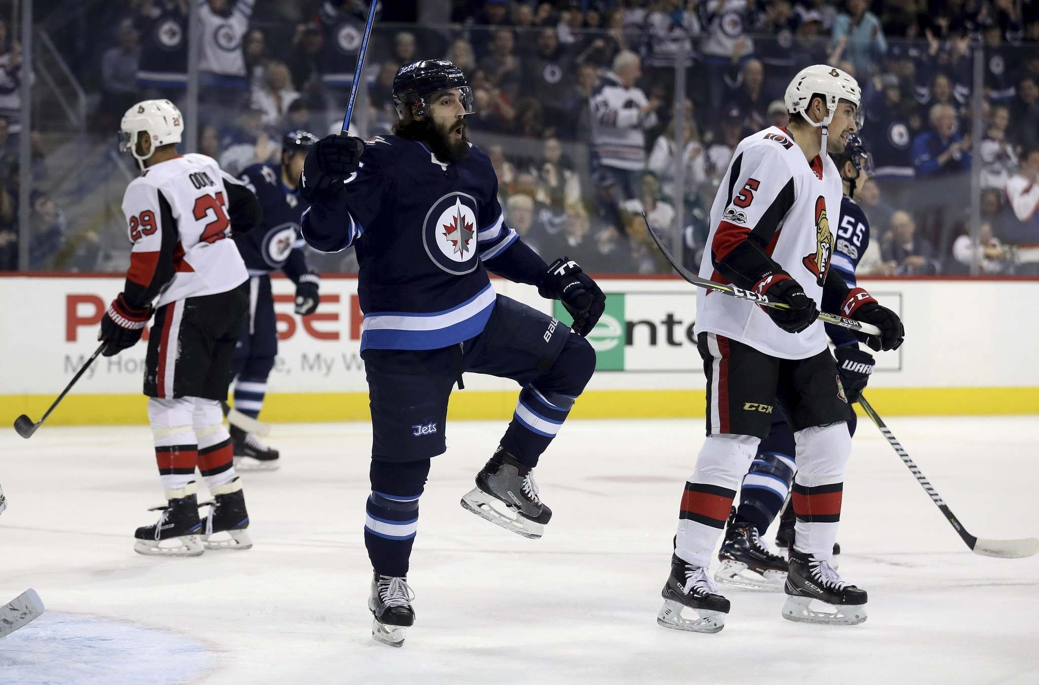 TREVOR HAGAN / THE CANADIAN PRESS</p><p>Winnipeg Jets&#39; Mathieu Perreault (85) celebrates after scoring against the Ottawa Senators during first period NHL hockey action in Winnipeg, Sunday, December 3, 2017.</p>