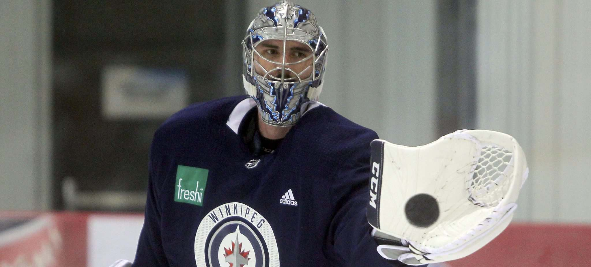 BORIS MINKEVICH / WINNIPEG FREE PRESS</p><p>Winnipeg Jets goalie Connor Hellebuyck surveys the Bell MTS Iceplex during practice Friday. He'll start in net for one of the two games against the St. Louis Blues this weekend, while Steve Mason gets the nod from coach Paul Maurice in the other contest.</p></p>