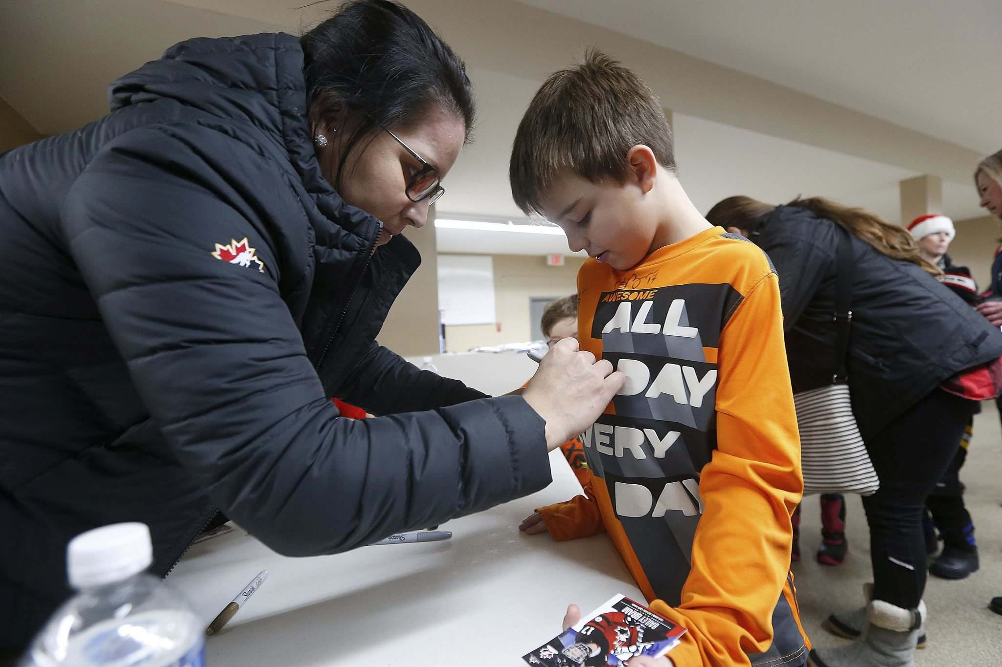 JOHN WOODS / WINNIPEG FREE PRESS</p><p>Team Canada hockey player Brigette Lacquette signs an autograph for Luca Normandeau in St Anne.</p>