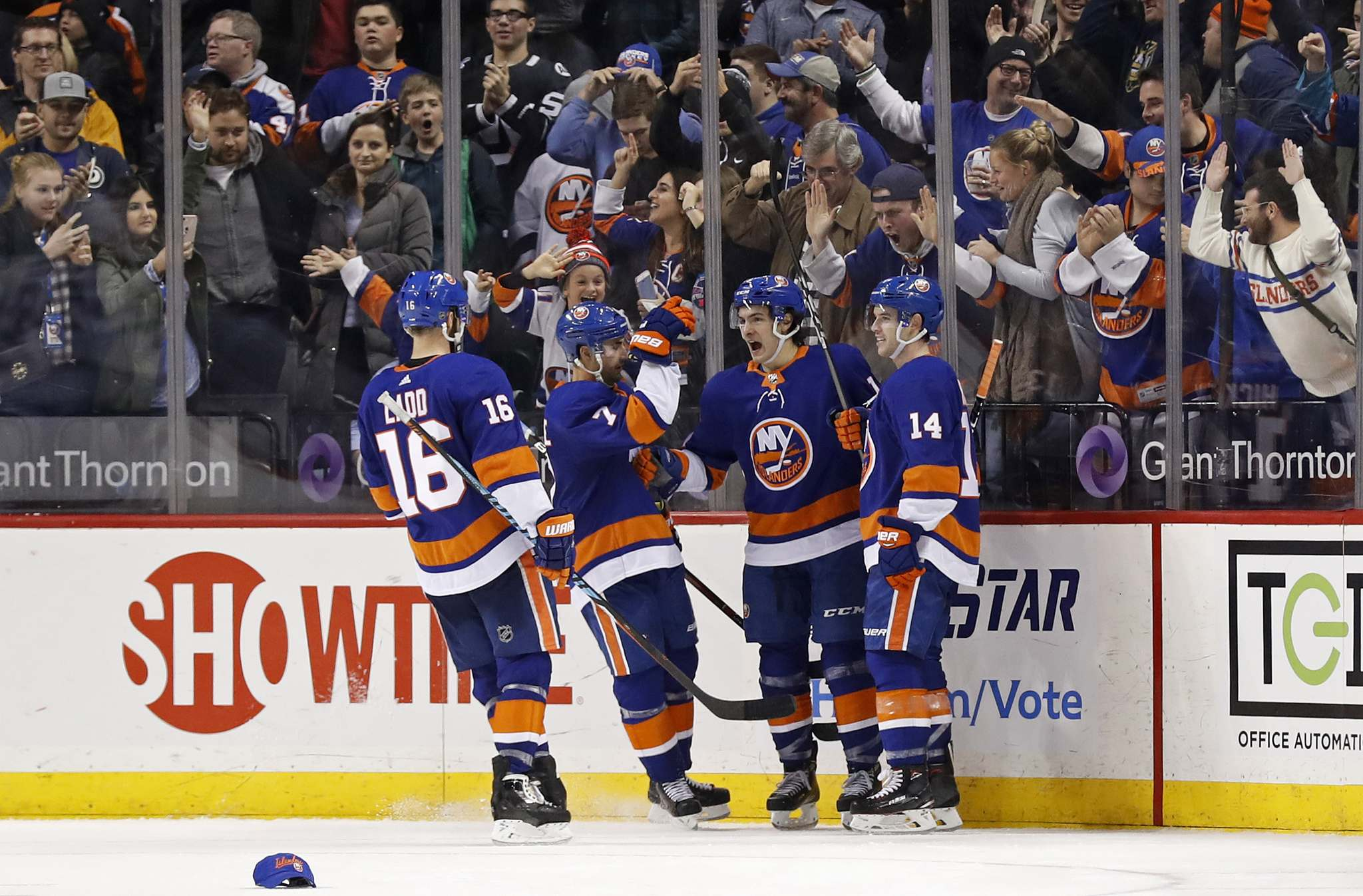 Mathew Barzal, second right, celebrates after scoring his third goal of the game against the Jets. (Adam Hunger / Associated Press files)</p>