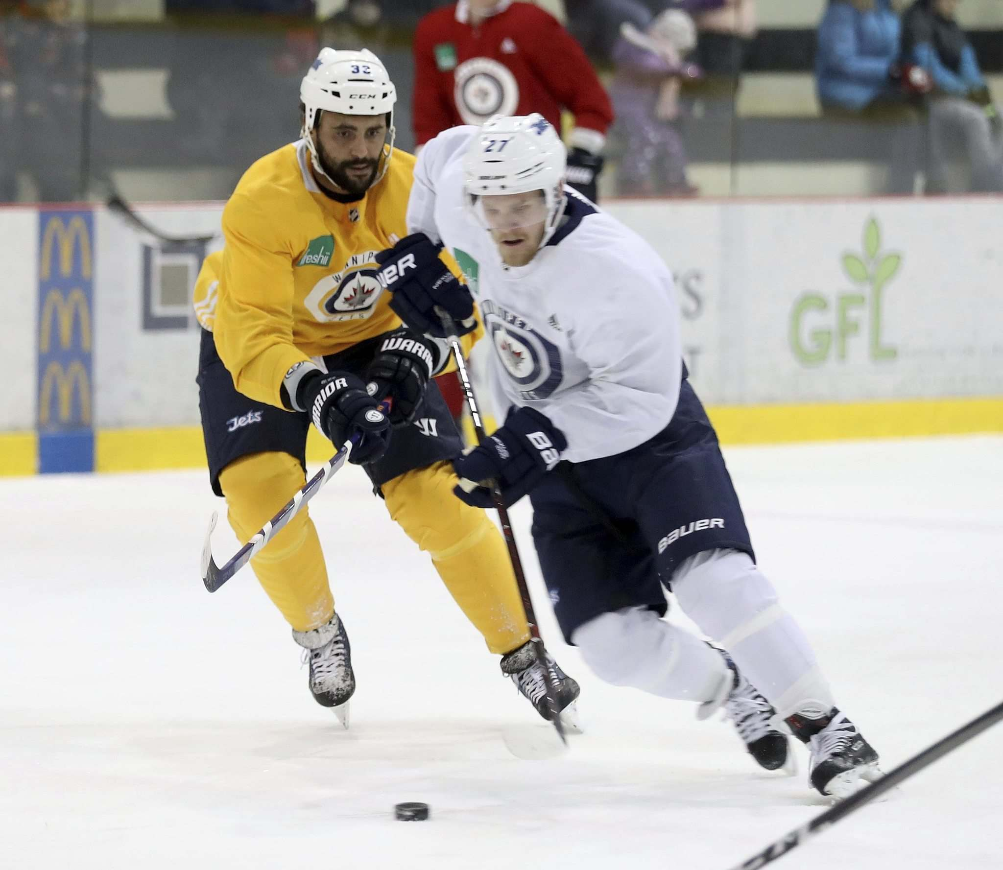 Winnipeg Jets&#39; Dustin Byfuglien (33) and Nikolaj Ehlers (27) at practice Saturday at the Iceplex. Byfuglien will draw back into the lineup tonight. (Trevor Hagan / Winnipeg Free Press)</p>