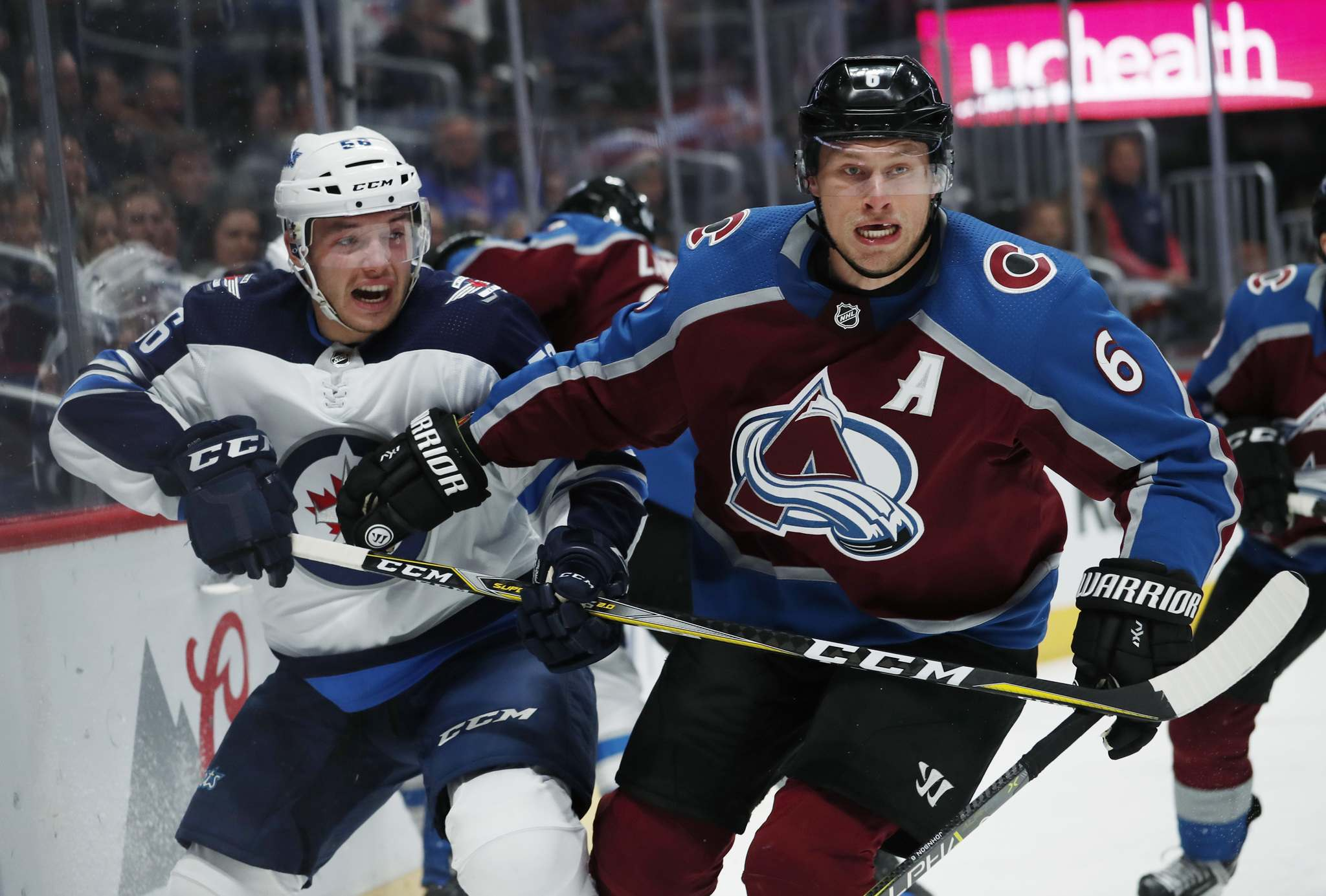<p>Colorado Avalanche defenseman Erik Johnson, right, checks Winnipeg Jets center Marko Dano, of Austria, as they pursue the puck in the second period of an NHL hockey game Tuesday, Jan. 2, 2018, in Denver. </p>