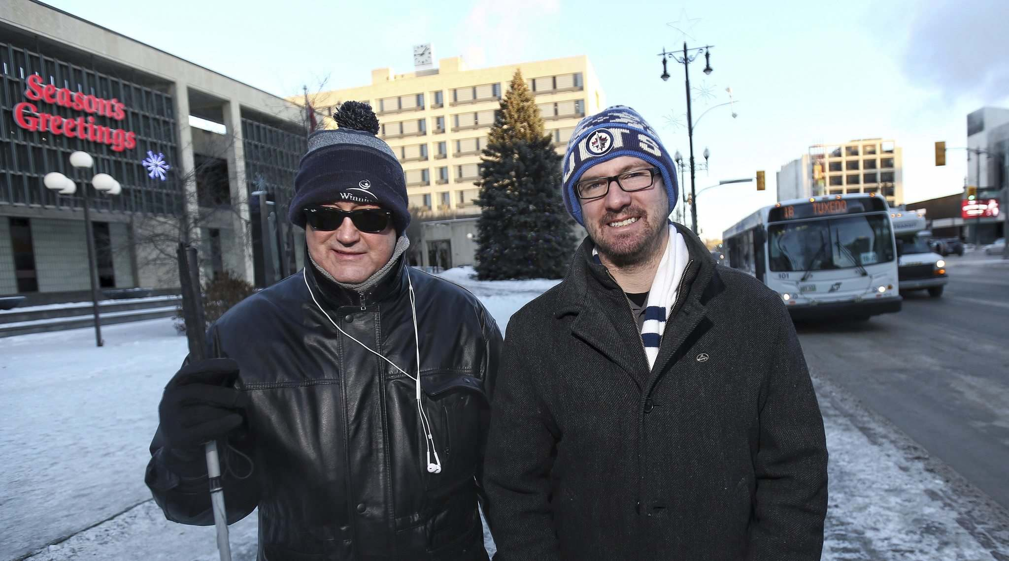 MIKE DEAL / WINNIPEG FREE PRESS</p><p>Coun. Ross Eadie (left) already buses to work every day, while Coun. Matt Allard set his own challenge for the month of January.</p>