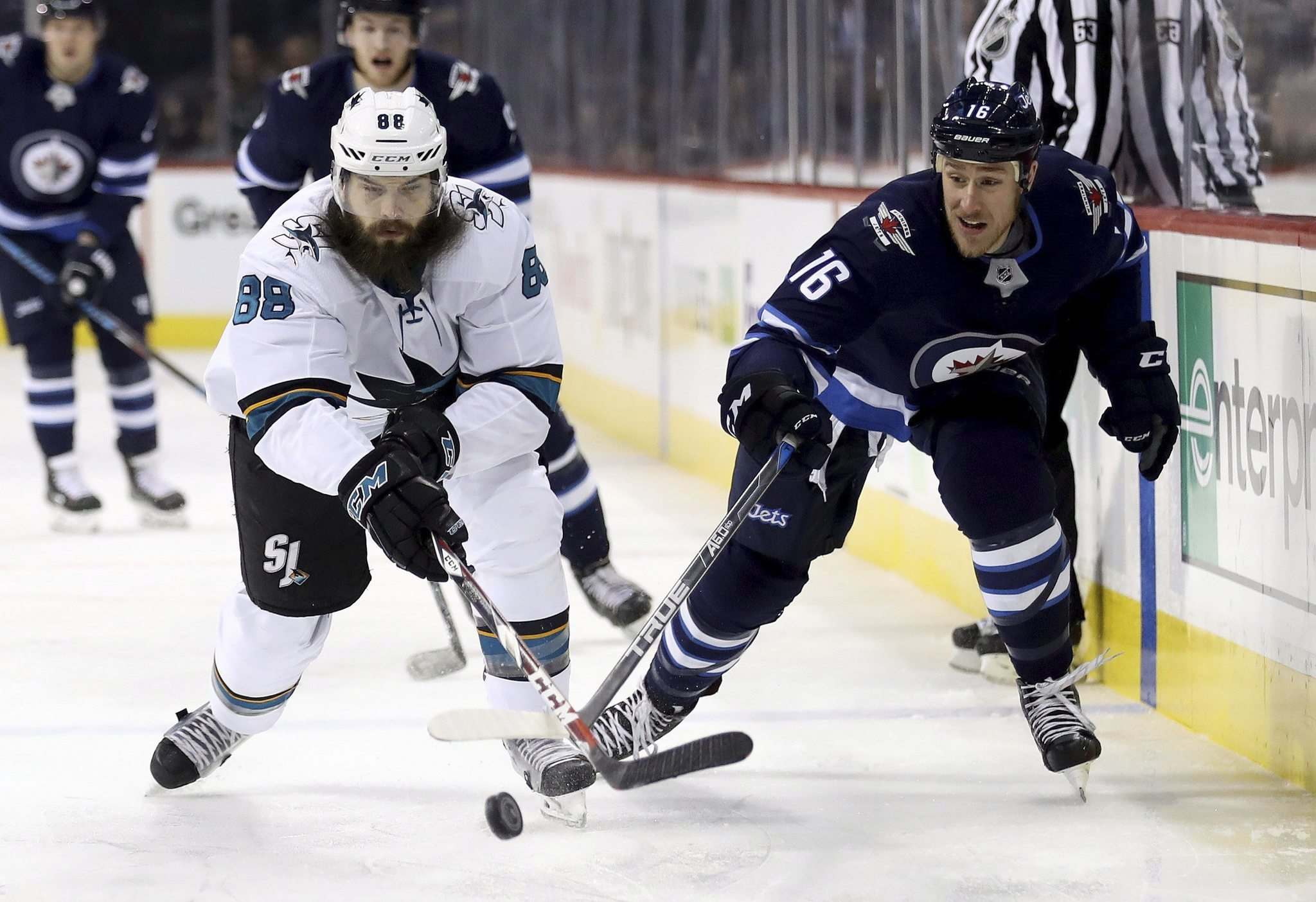 TREVOR HAGAN / THE CANADIAN PRESS</p><p>Shawn Matthias races for the puck during Sunday&#39;s game against the Sharks in Winnipeg.</p>