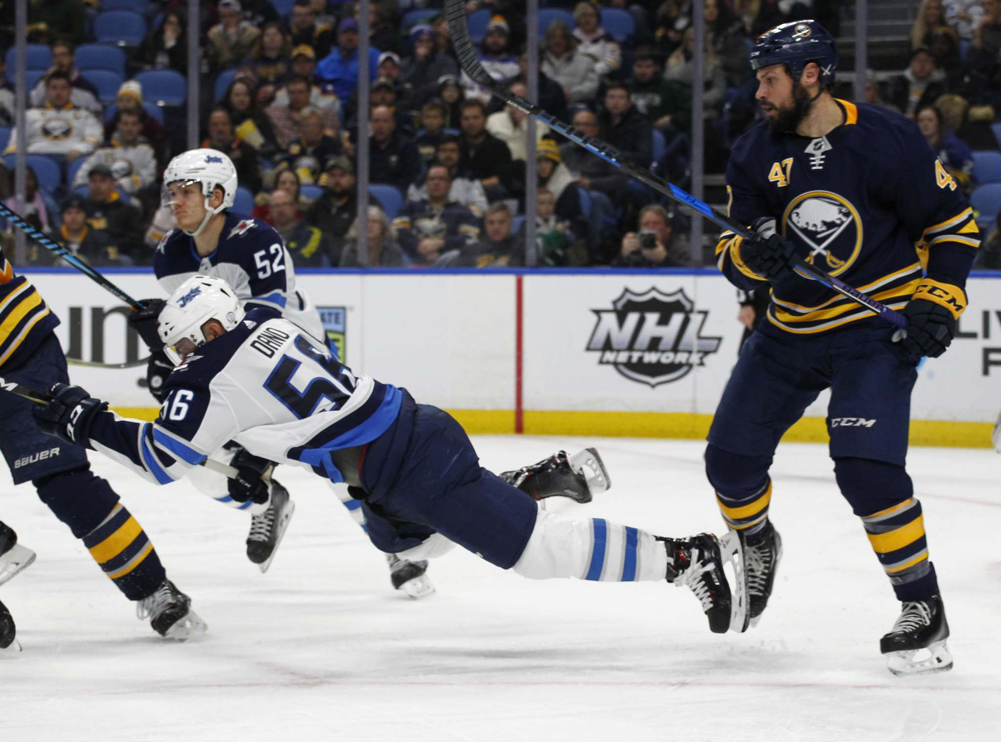 Jeffrey T. Barnes / The Associated Press</p><p>Buffalo Sabres defenseman Zach Bogosian (47) trips Winnipeg Jets forward Marko Dano (56) during the second period of an NHL hockey game, Tuesday, Jan. 9, 2018, in Buffalo, N.Y.</p>
