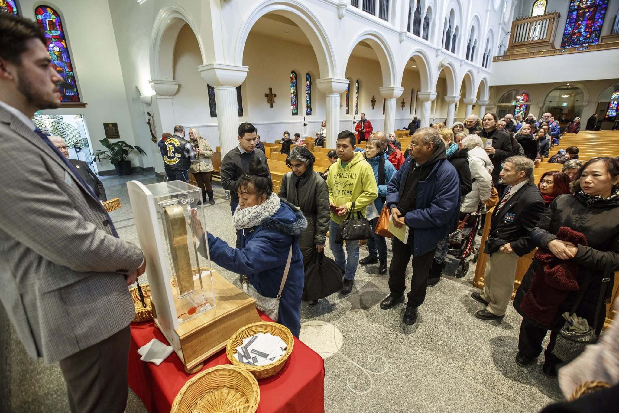 MIKE DEAL / WINNIPEG FREE PRESS</p><p>Parishioners take part in the public venerations of the relic of St. Francis Xavier.</p>