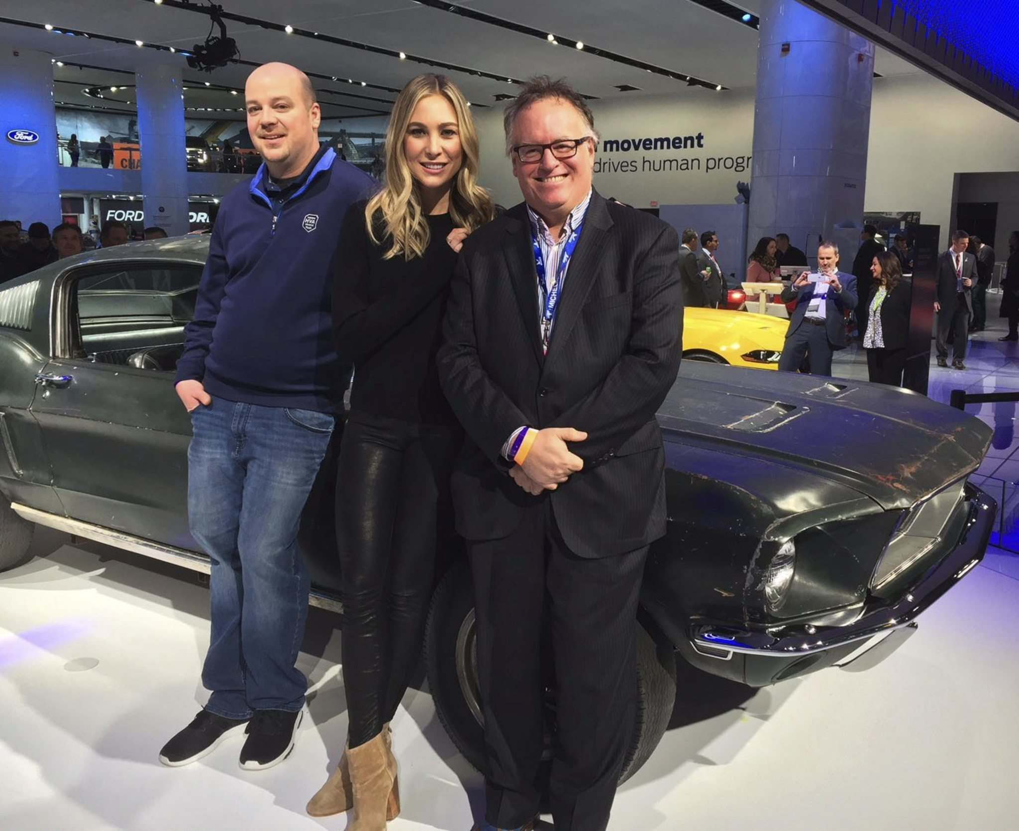 SuppliedSean Kiernan (from left), Molly McQueen and Free Press automotive journalist Kelly Taylor with the original 1968 Mustang from the movie Bullitt, starring McQueen's grandfather Steve.