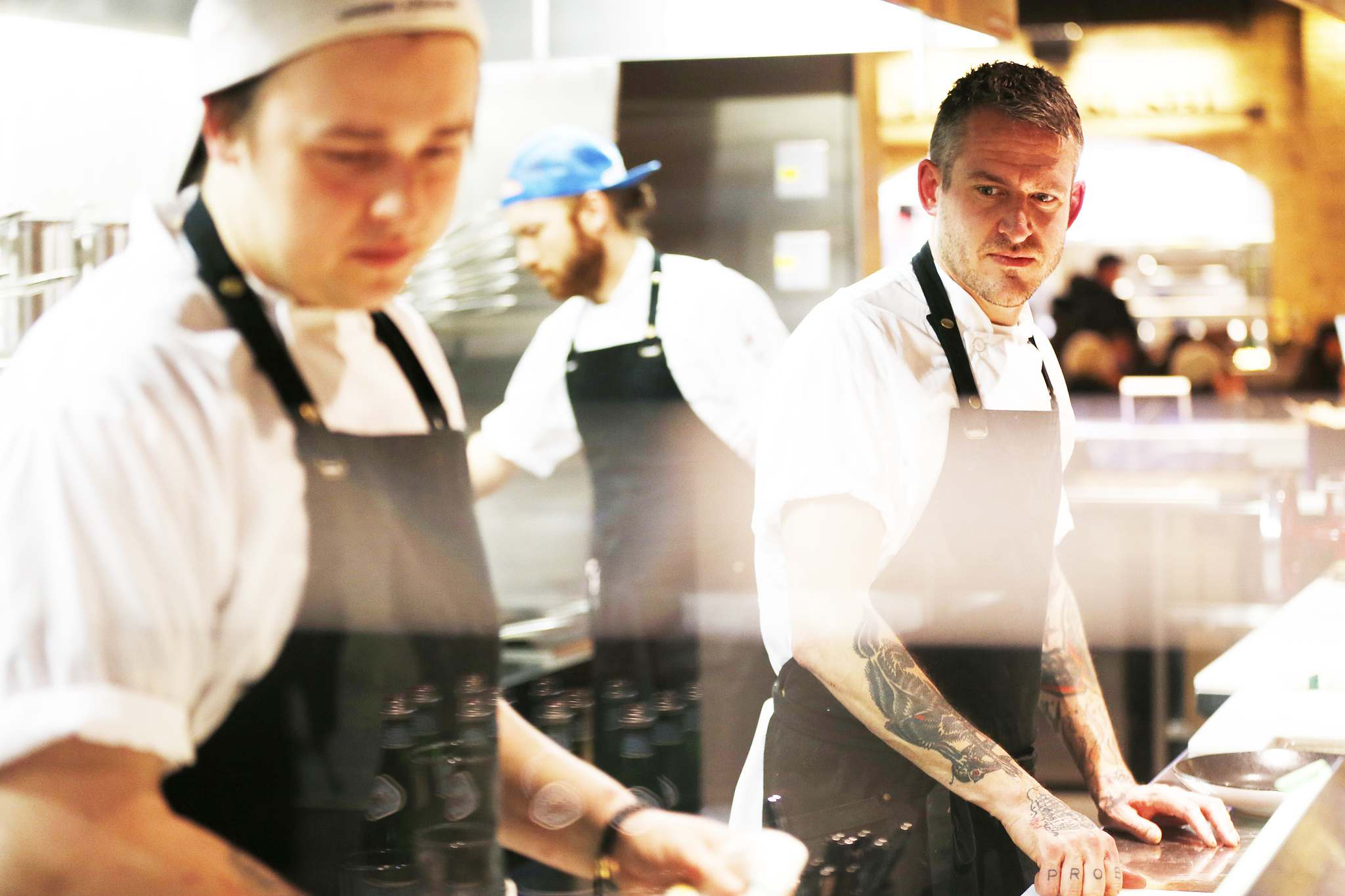 JOHN WOODS / WINNIPEG FREE PRESS</p><p>Chef Scott Bagshaw (right) oversees the line with line cooks Cody Meindl (left) and Scott Ball at Passero in The Forks.</p>