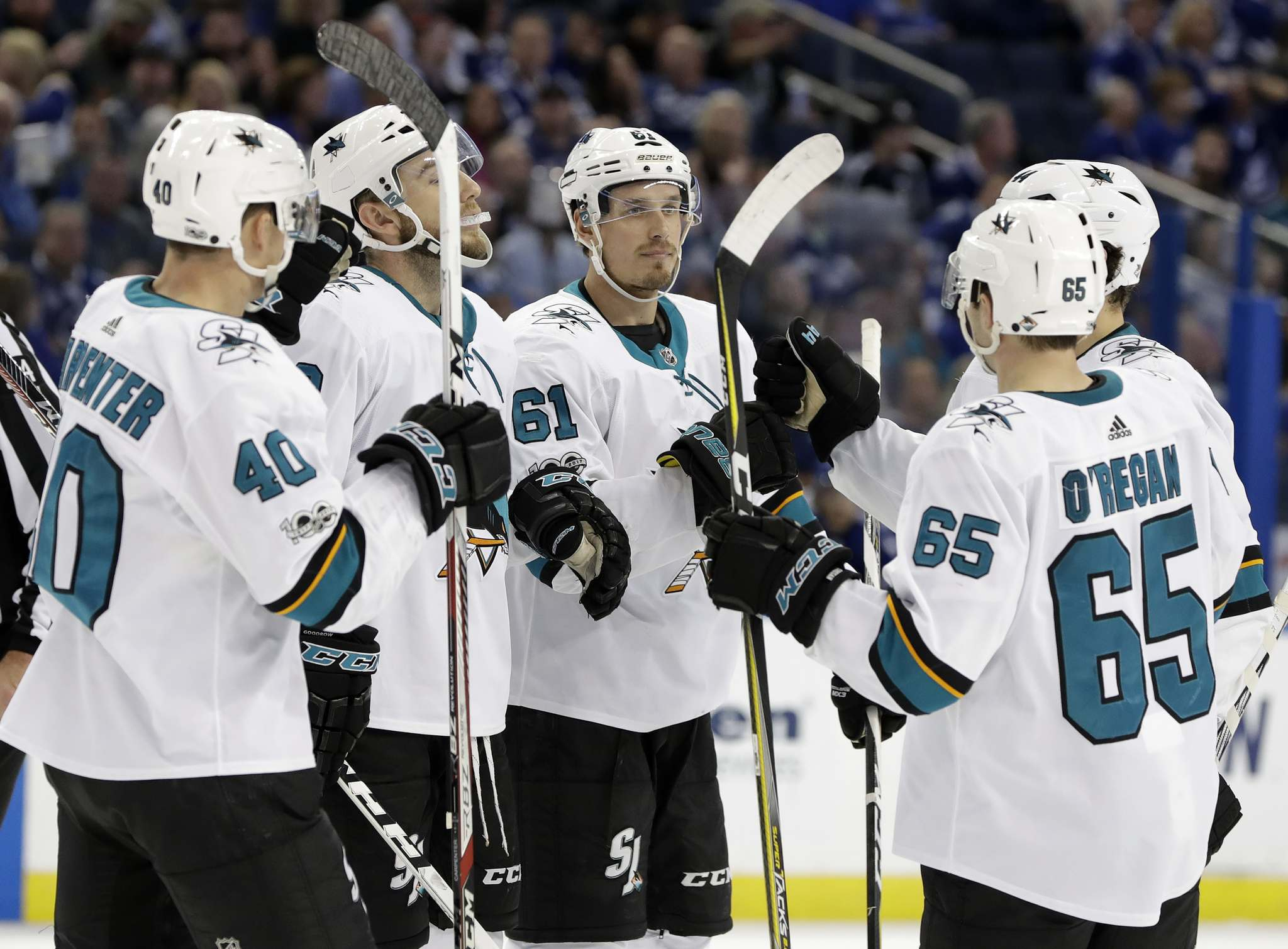 Chris O'Meara / The Associated Press files</p><p>San Jose Sharks defenceman Justin Braun (centre) celebrates with teammates during the third period of a game on Dec. 2, 2017, in Tampa, Fla.</p>