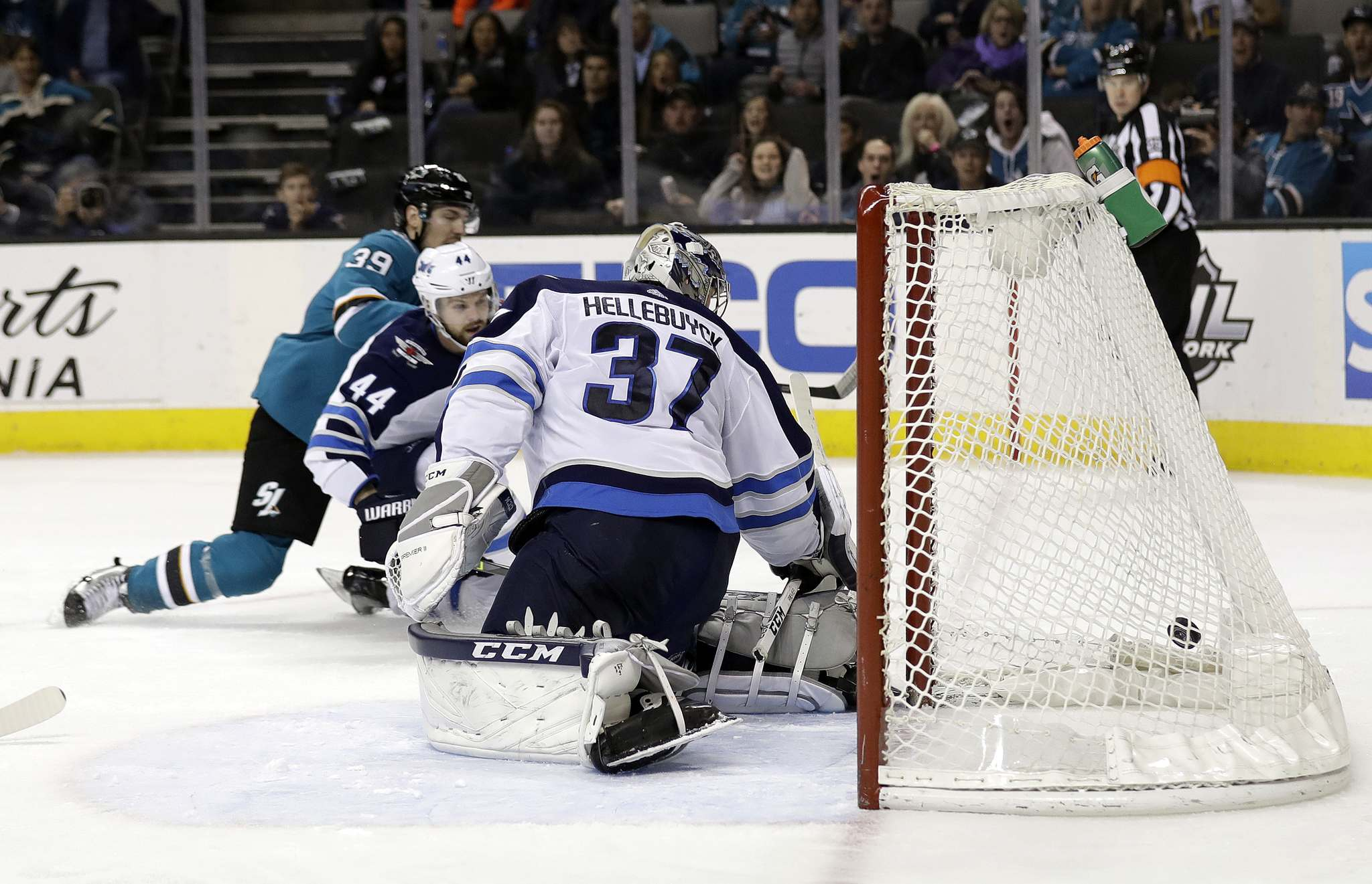 (AP Photo/Marcio Jose Sanchez)</p><p>Winnipeg Jets goaltender Connor Hellebuyck gives up a goal to San Jose Sharks centre Logan Couture, left, during the second period Tuesday.</p>
