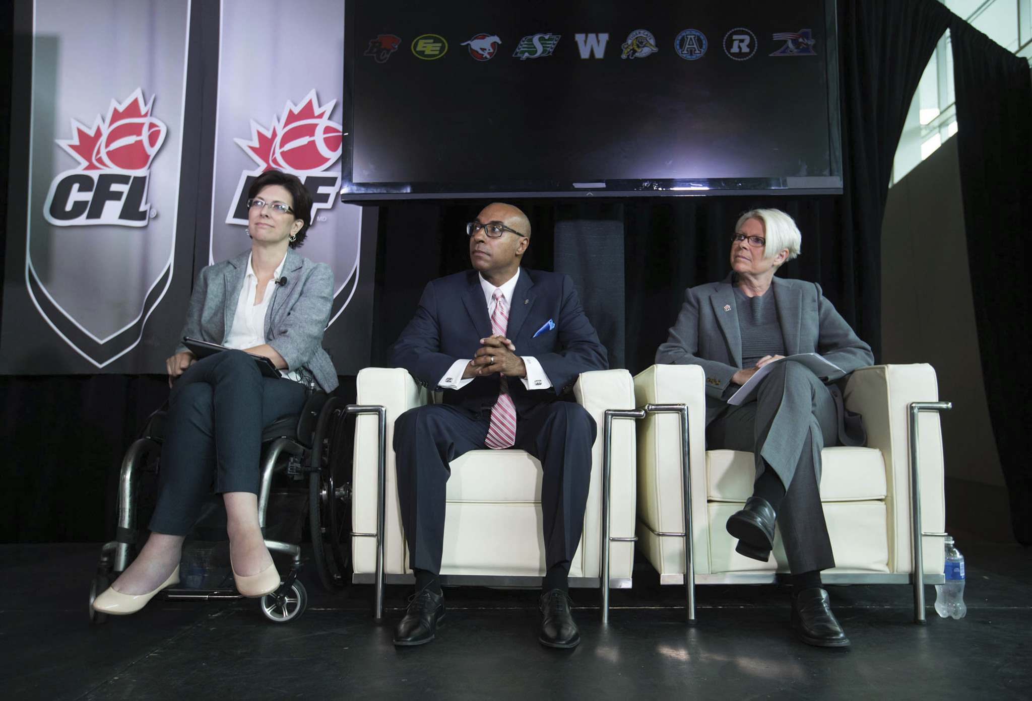 Former B.C. minister for children and family development Stephanie Cadieux, then-CFL commissioner Jeffrey Orridge and Tracy Porteous of EVA Canada unveil the league's anti-violence policy in Vancouver in 2015. (Canadian Football League photo)